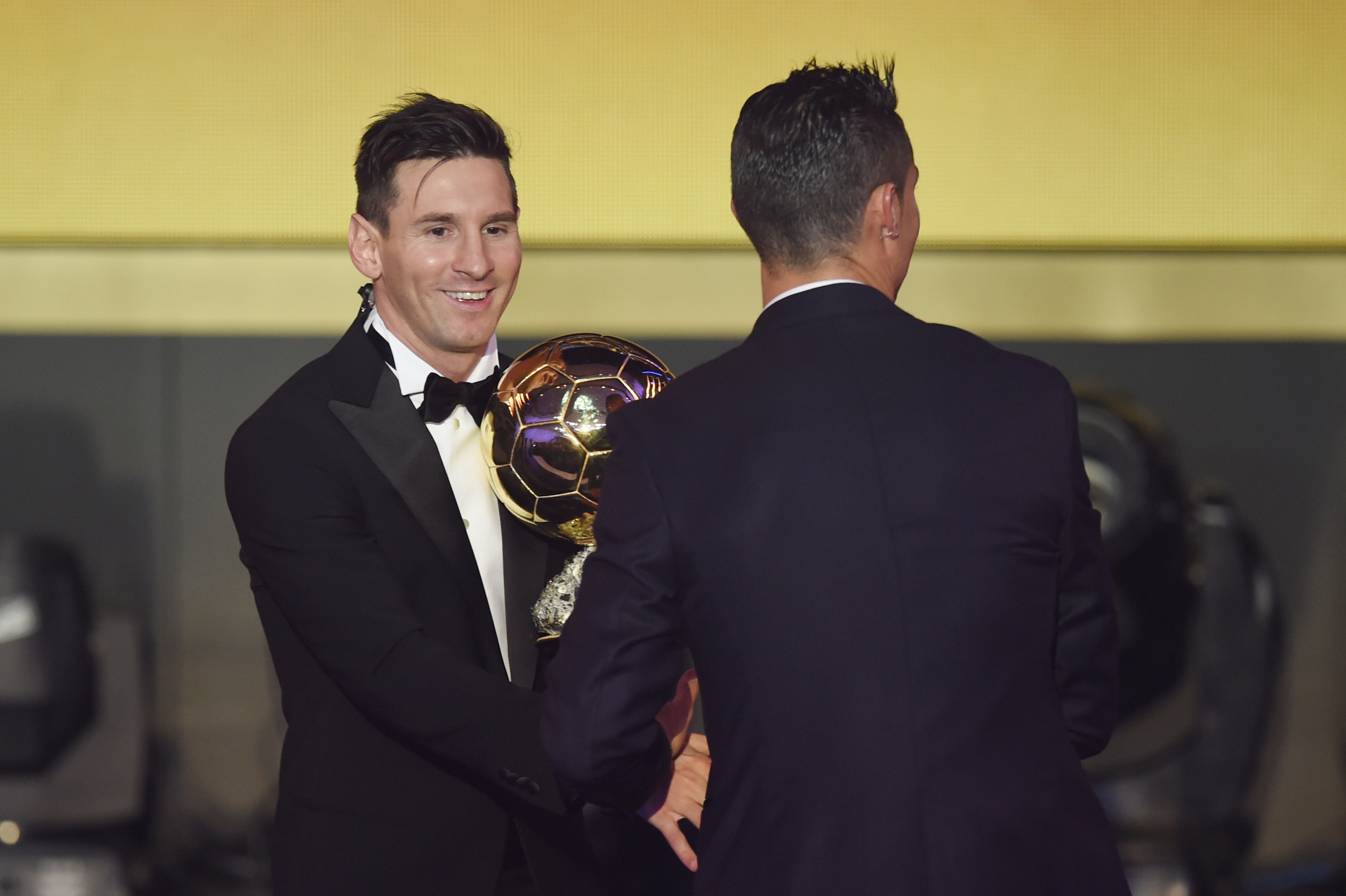 ZURICH, SWITZERLAND - JANUARY 11:  Lionel Messi of Argentina and FC Barcelona the winner of the Ballon d'or is congratulated byCristiano Ronaldo of Portugal and Real Madrid during the FIFA Ballon d'Or Gala 2015 at the Kongresshaus on January 11, 2016 in Zurich, Switzerland.  (Photo by Matthias Hangst/Getty Images)