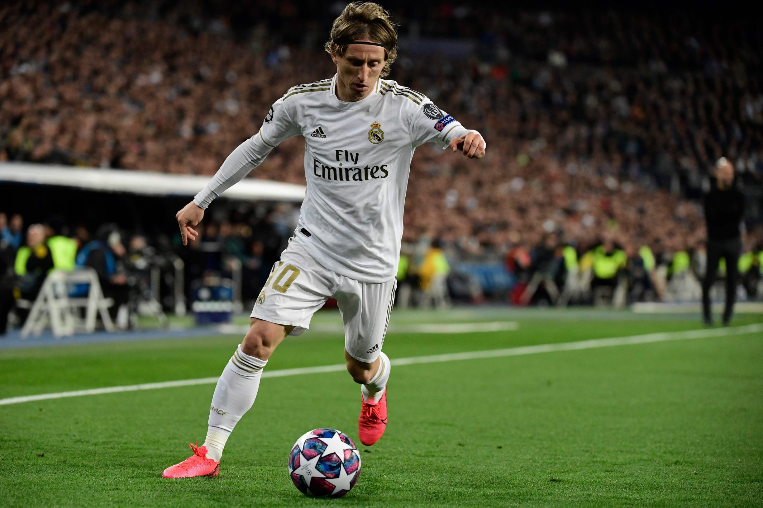 Real Madrid's Croatian midfielder Luka Modric controls the ball during the UEFA Champions League round of 16 first-leg football match between Real Madrid CF and Manchester City at the Santiago Bernabeu stadium in Madrid on February 26, 2020. (Photo by JAVIER SORIANO / AFP)