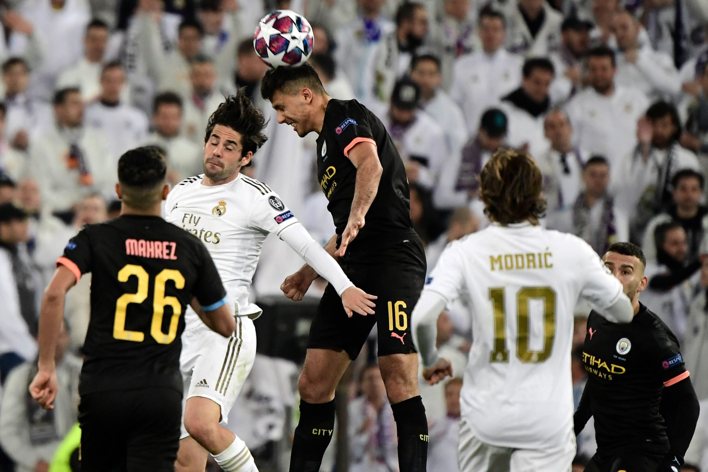 Real Madrid's Spanish midfielder Isco (2L) vies with Manchester City's Spanish midfielder Rodri during the UEFA Champions League round of 16 first-leg football match between Real Madrid CF and Manchester City at the Santiago Bernabeu stadium in Madrid on February 26, 2020. (Photo by JAVIER SORIANO / AFP)