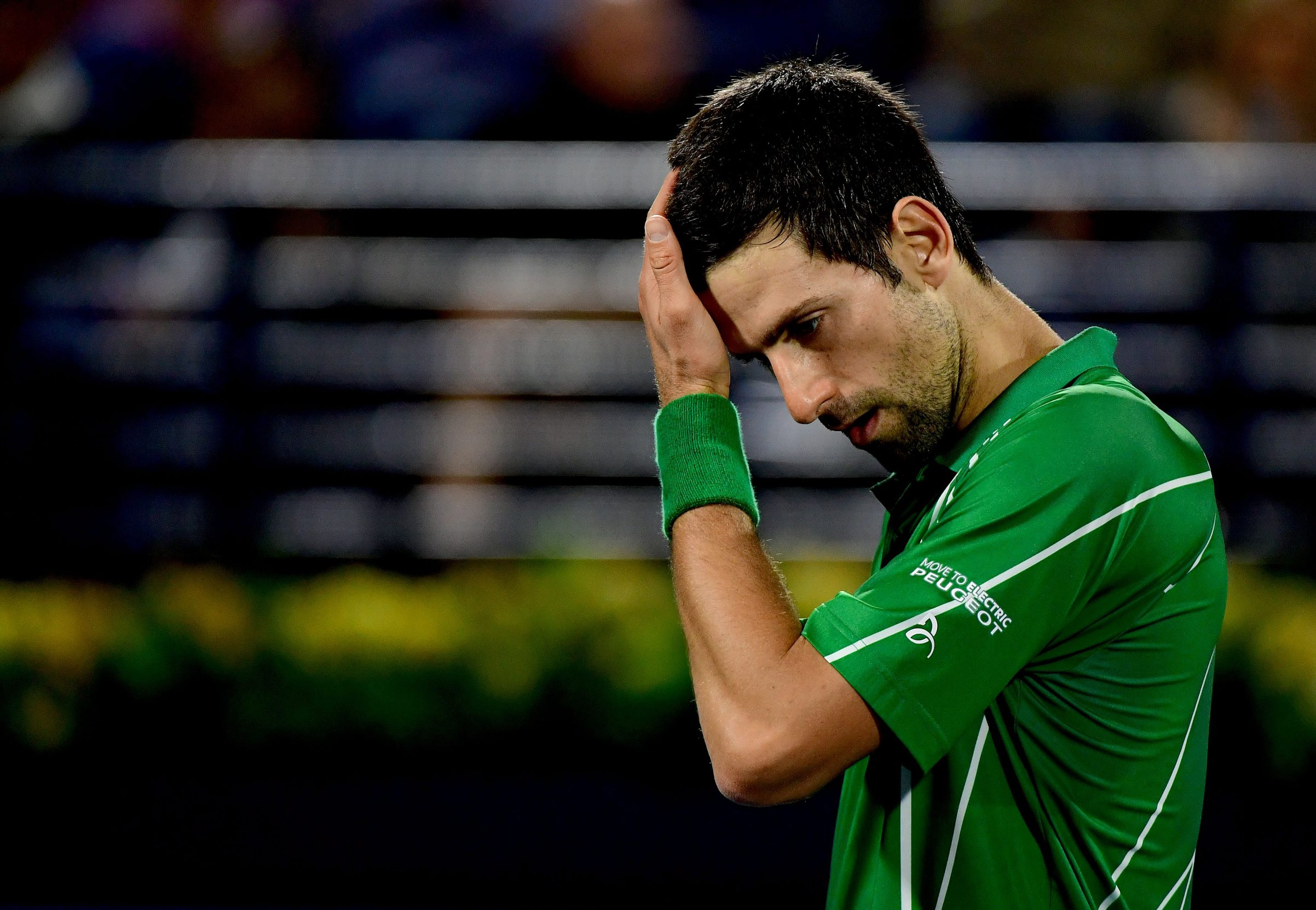 Serbia's Novak Djokovic reacts during the quarter-finals of the Dubai Duty Free Tennis Championship in the Gulf emirate of Dubai on February 27, 2020. (Photo by - / AFP)