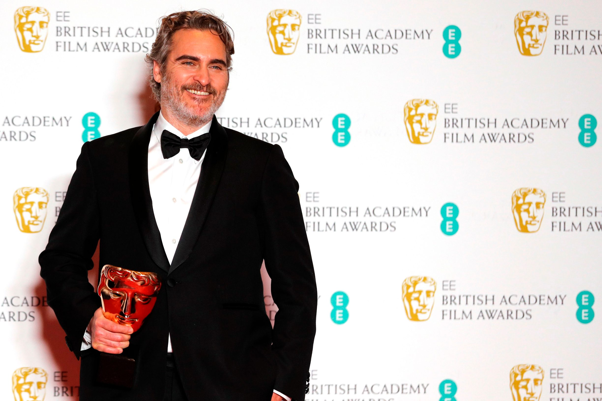 US actor Joaquin Phoenix poses with the award for a Leading Actor for his work on the film 'Joker' at the BAFTA British Academy Film Awards at the Royal Albert Hall in London on February 2, 2020. (Photo by Adrian DENNIS / AFP)