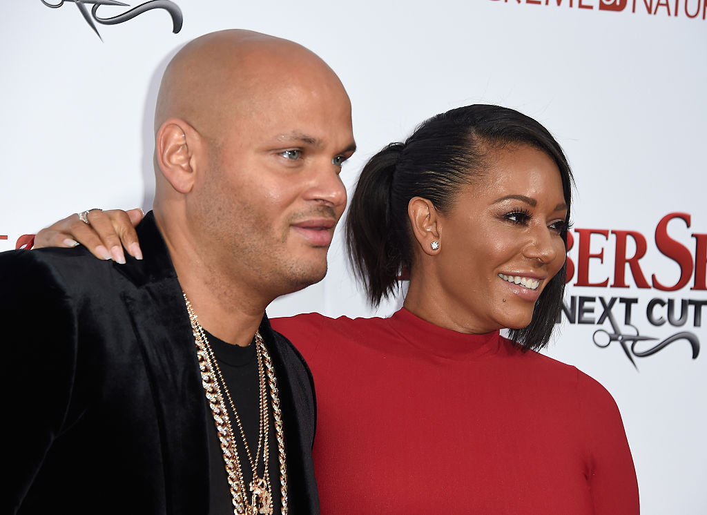 HOLLYWOOD, CALIFORNIA - APRIL 06:  Stephen Belafonte and actress/musician Melanie Brown attend the  Premiere Of New Line Cinema's