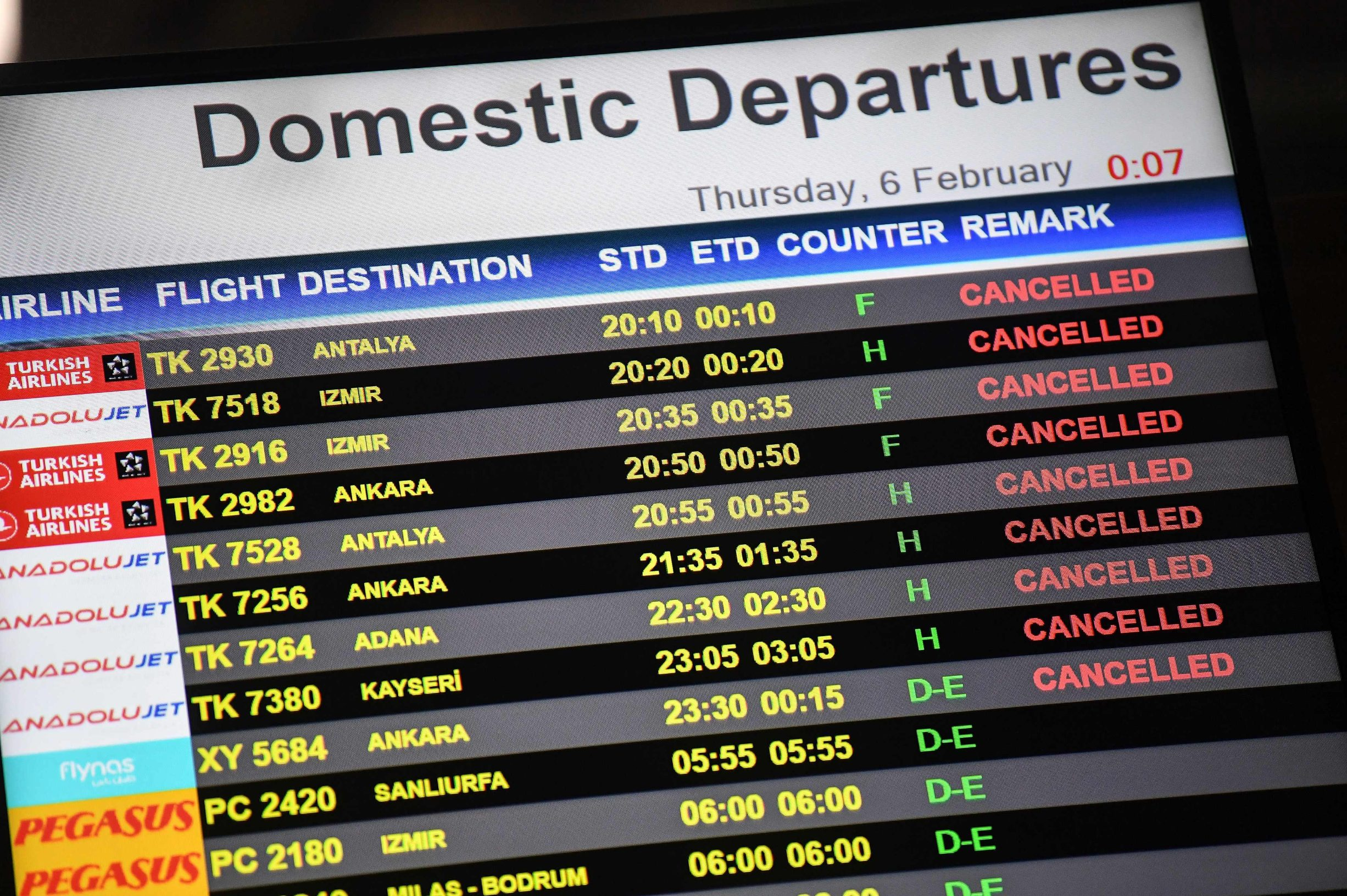 A digital display shows cancelled flights at Sabiha Gokcen International airport after a Pegasus Airlines Boeing 737 airplane skidded off the runway upon landing at Sabiha Gokcen airport in Istanbul on February 5, 2020. - One person died and 157 were injured when a plane carrying 177 people skidded off the runway at an Istanbul airport, caught fire and split into three after landing in rough weather on February 5. (Photo by Ozan KOSE / AFP)