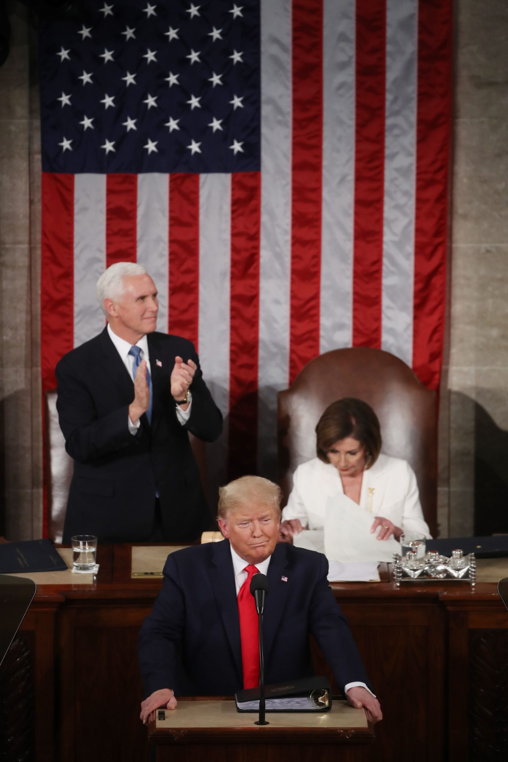 WASHINGTON, DC - FEBRUARY 04: House Speaker Rep. Nancy Pelosi (D-CA) and Vice President Mike Pence applaud as President Donald Trump steps to the lectern for the State of the Union address in the chamber of the U.S. House of Representatives on February 04, 2020 in Washington, DC. President Trump delivers his third State of the Union to the nation the night before the U.S. Senate is set to vote in his impeachment trial.   Mark Wilson/Getty Images/AFP == FOR NEWSPAPERS, INTERNET, TELCOS & TELEVISION USE ONLY ==