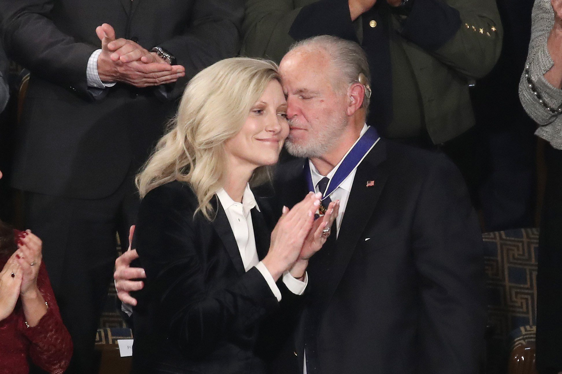 WASHINGTON, DC - FEBRUARY 04: Radio personality Rush Limbaugh embraces his wife Kathryn Adams Limbaugh after First Lady Melania Trump gives him the Presidential Medal of Freedom during the State of the Union address in the chamber of the U.S. House of Representatives on February 04, 2020 in Washington, DC. President Trump delivers his third State of the Union to the nation the night before the U.S. Senate is set to vote in his impeachment trial.   Drew Angerer/Getty Images/AFP == FOR NEWSPAPERS, INTERNET, TELCOS & TELEVISION USE ONLY ==