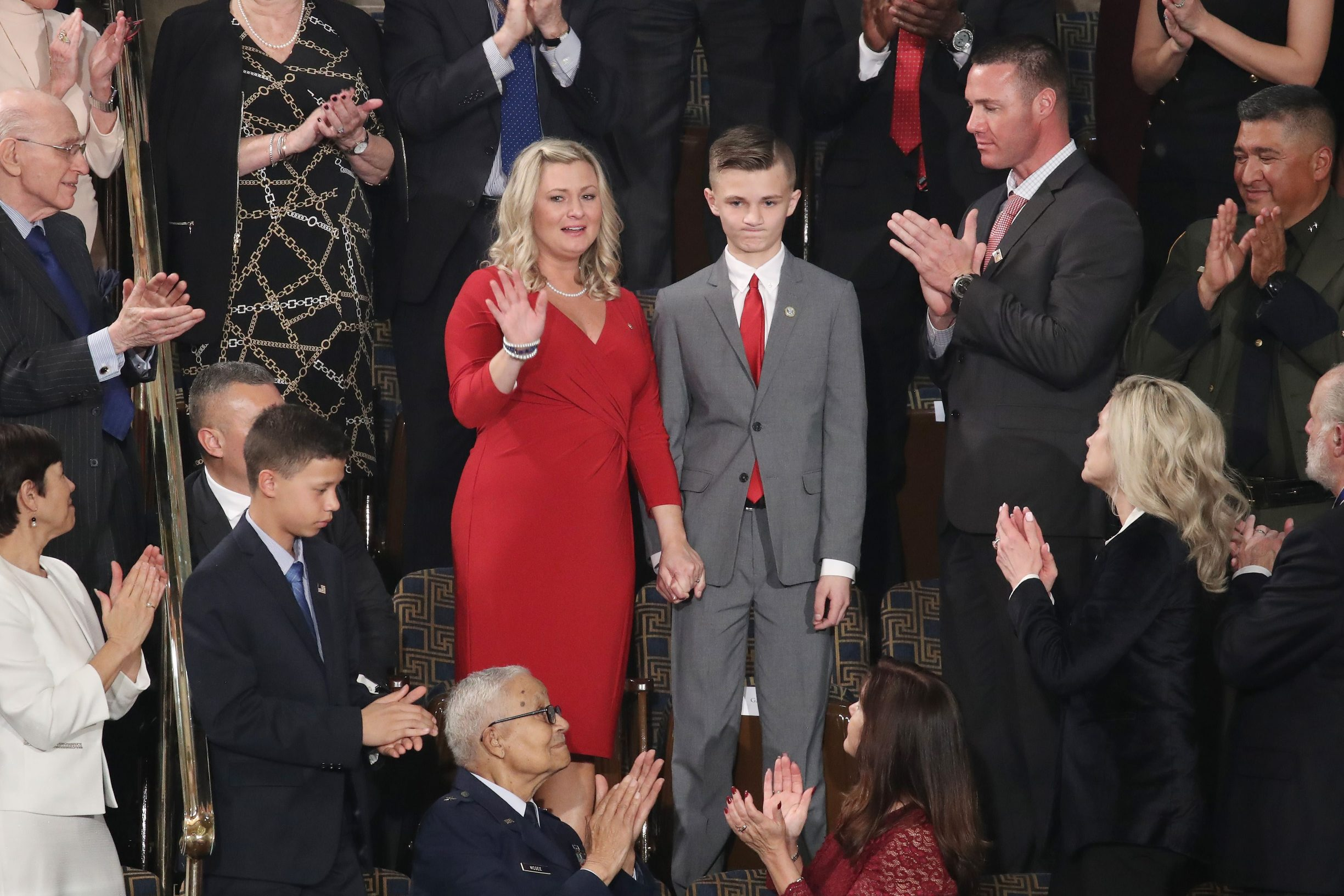 WASHINGTON, DC - FEBRUARY 04: Kelli Hake, the widow of a U.S. soldier killed in Iraq in 2008, atends the State of the Union address with her son, Gage Hake, in the chamber of the U.S. House of Representatives on February 04, 2020 in Washington, DC. President Trump delivers his third State of the Union to the nation the night before the U.S. Senate is set to vote in his impeachment trial.   Drew Angerer/Getty Images/AFP == FOR NEWSPAPERS, INTERNET, TELCOS & TELEVISION USE ONLY ==
