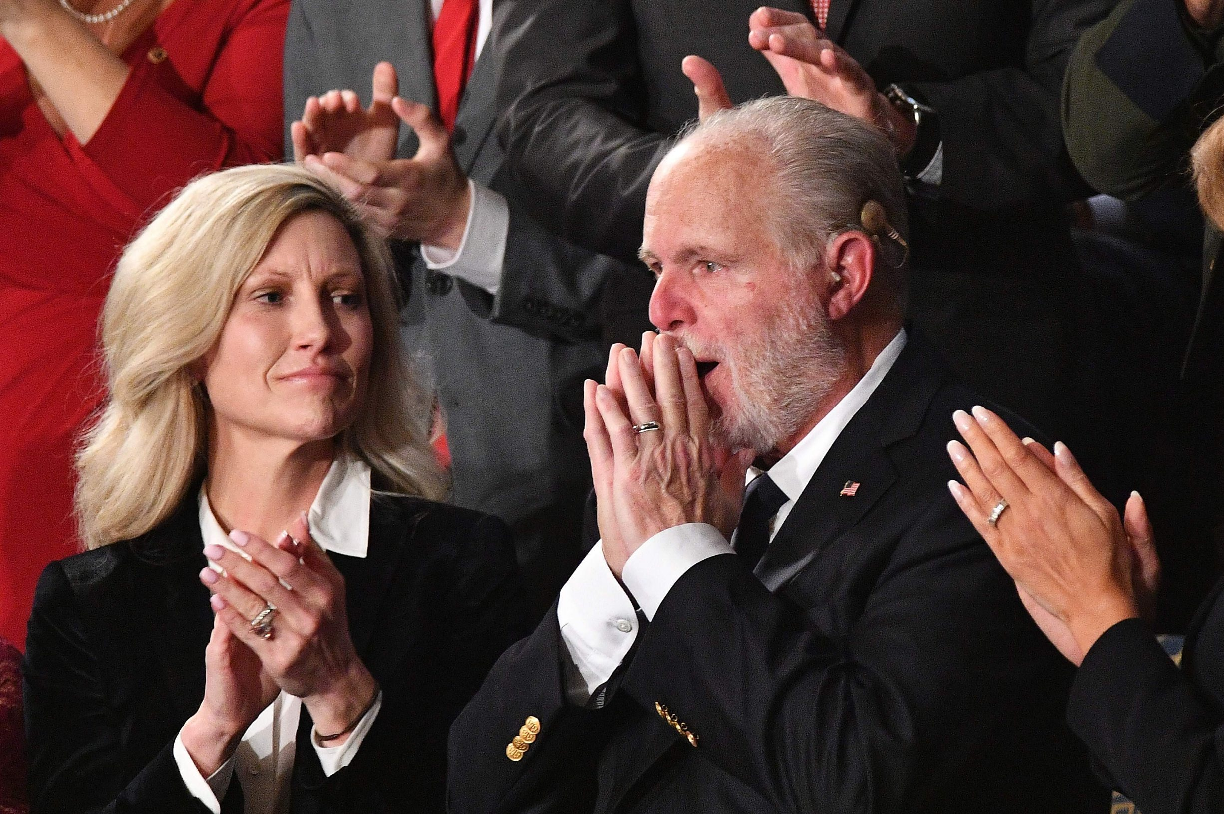 Radio personality Rush Limbaugh gestures after being awarded the Medal of Freedom by US President Donald Trump as he delivers the State of the Union address at the US Capitol in Washington, DC, on February 4, 2020. (Photo by MANDEL NGAN / AFP)