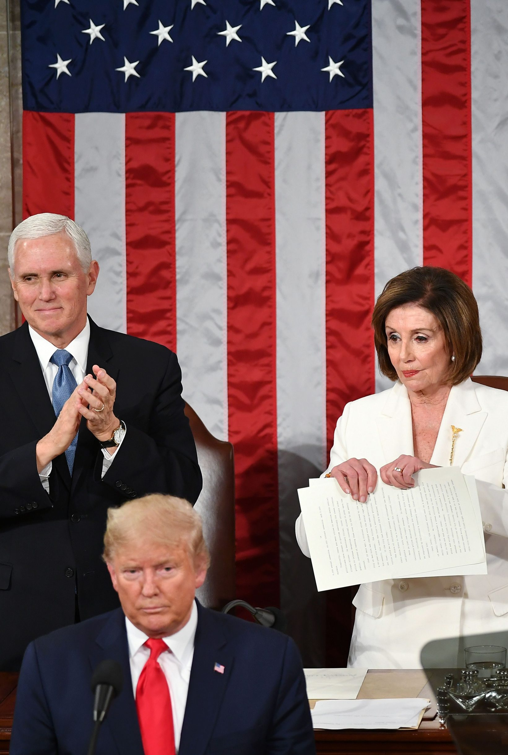Speaker of the US House of Representatives Nancy Pelosi rips a copy of US President Donald Trumps speech after he delivered the State of the Union address at the US Capitol in Washington, DC, on February 4, 2020. (Photo by MANDEL NGAN / AFP)