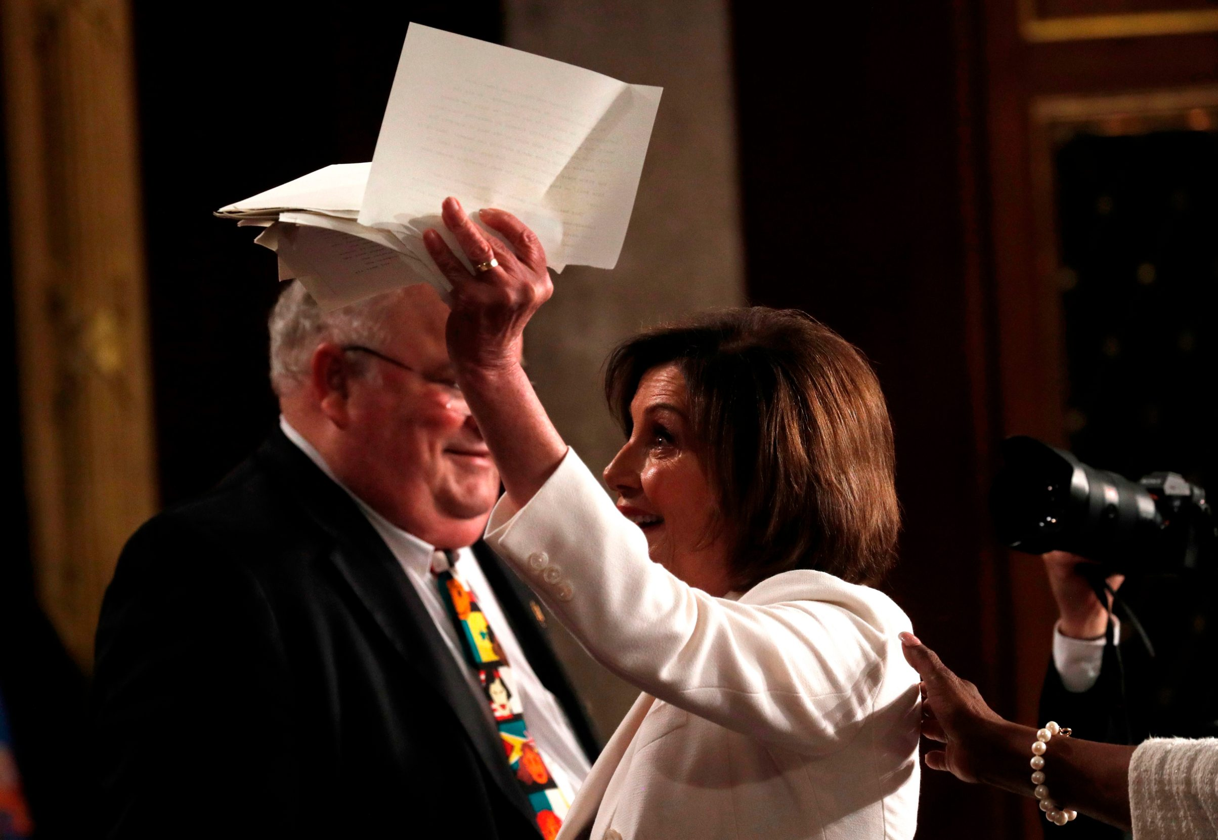 U.S. Speaker of the House Nancy Pelosi holds up her torn copy of President Donald Trump's speech after she tore it up at the conclusion of his State of the Union address at the US Capitol in Washington, DC, on February 4, 2020. (Photo by LEAH MILLIS / POOL / AFP)
