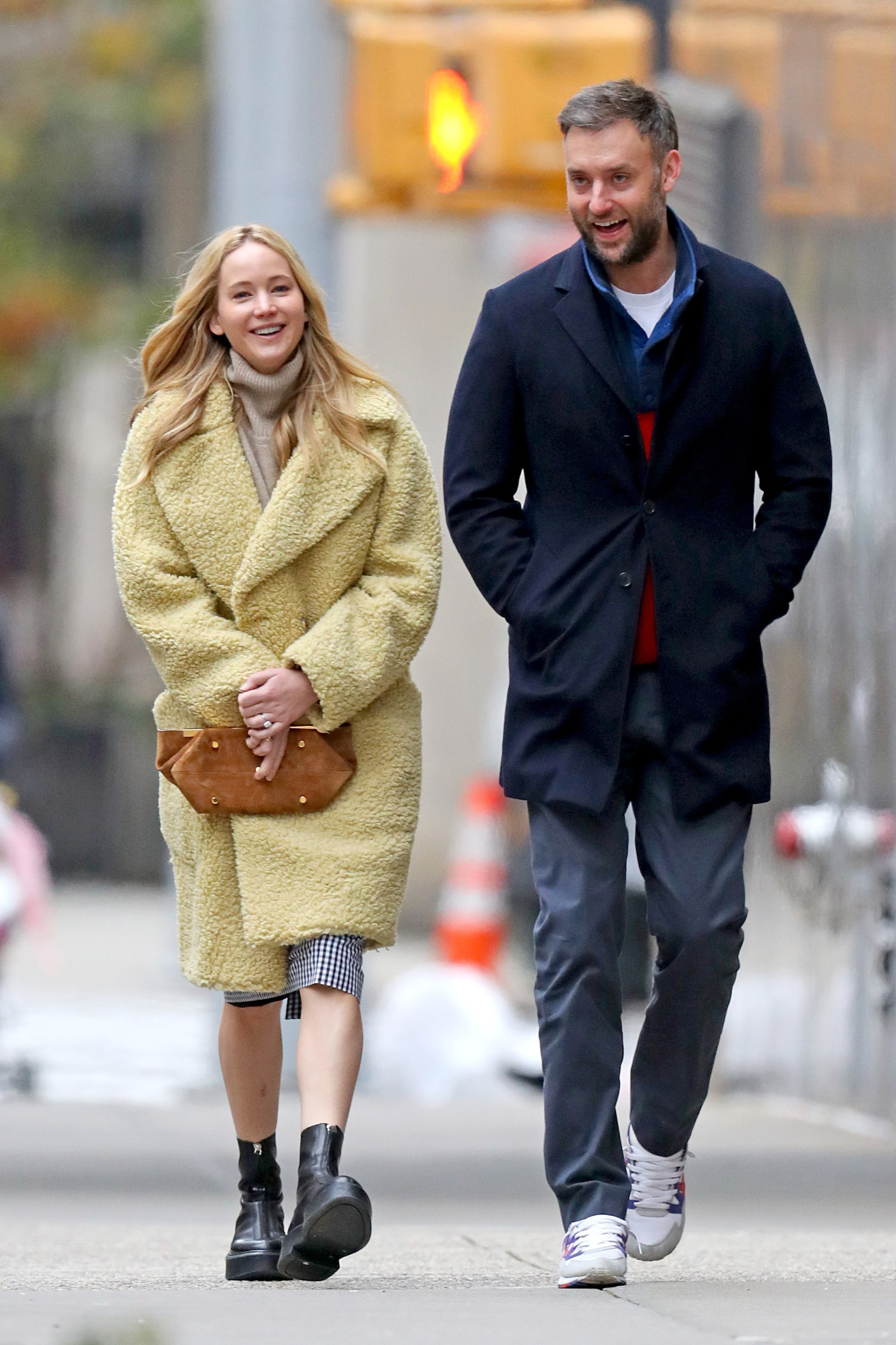 12/16/2019 EXCLUSIVE: Jennifer Lawrence and Cooke Maroney head to the MET Museum in New York City. The 29 year old actress wore an oversized yellow Burberry 'Willingstone' teddy coat, checkered dress, The Row black leather ankle boots, and carried a Khaite 'Aimee Clutch' in caramel suede., Image: 488609182, License: Rights-managed, Restrictions: Exclusive NO usage without agreed price and terms. Please contact sales@theimagedirect.com, Model Release: no, Credit line: TheImageDirect.com / The Image Direct / Profimedia