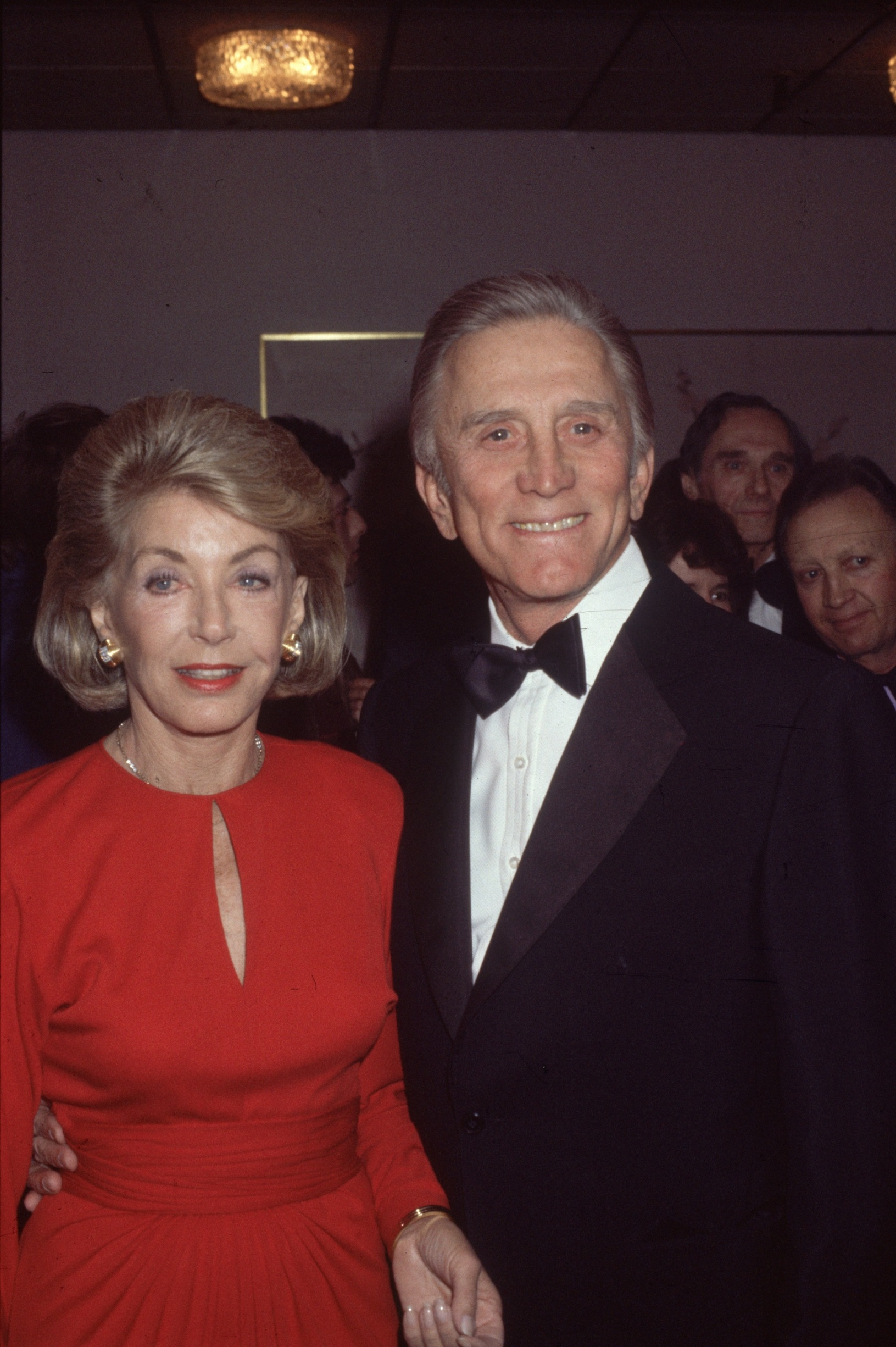 1985:  Film star Kirk Douglas with his wife Anne at the BAFTA Awards, Grosvenor House Hotel, London.  (Photo by Hulton Archive/Getty Images)