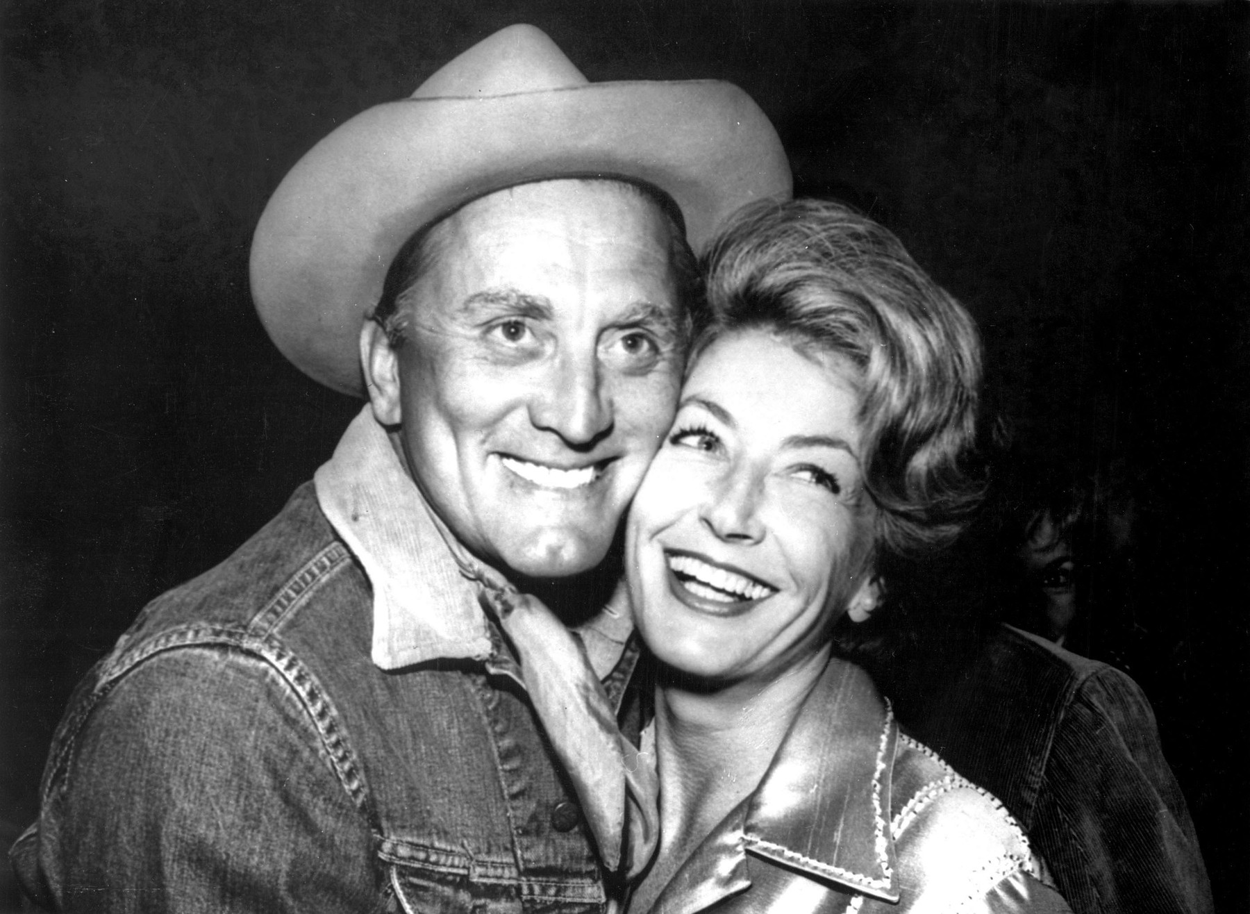 Jan 01, 1965 - Los Angeles, CA, USA - Once quoted as saying 'I've made a career of playing sons of bitches,' KIRK DOUGLAS (pictured here with his wife ANNE BUYDENS) is considered by many to be the epitome of the Hollywood hard man. In addition to acting in countless films over the course of his long career, Douglas has served as a director and producer, and will forever be associated with his role in helping to put an end to the infamous Hollywood black list., Image: 210154226, License: Rights-managed, Restrictions: NOT FOR FRANCE!!!, Model Release: no, Credit line: KEYSTONE Pictures USA / Zuma Press / Profimedia