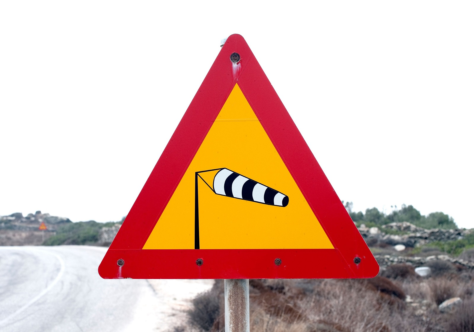 Greek road sign warning against the possibility of strong winds. Taken near Chora on Amorgos,  the easternmost island of the Greek Cyclades., Image: 136209954, License: Rights-managed, Restrictions: , Model Release: no, Credit line: pierre rochon / Alamy / Profimedia