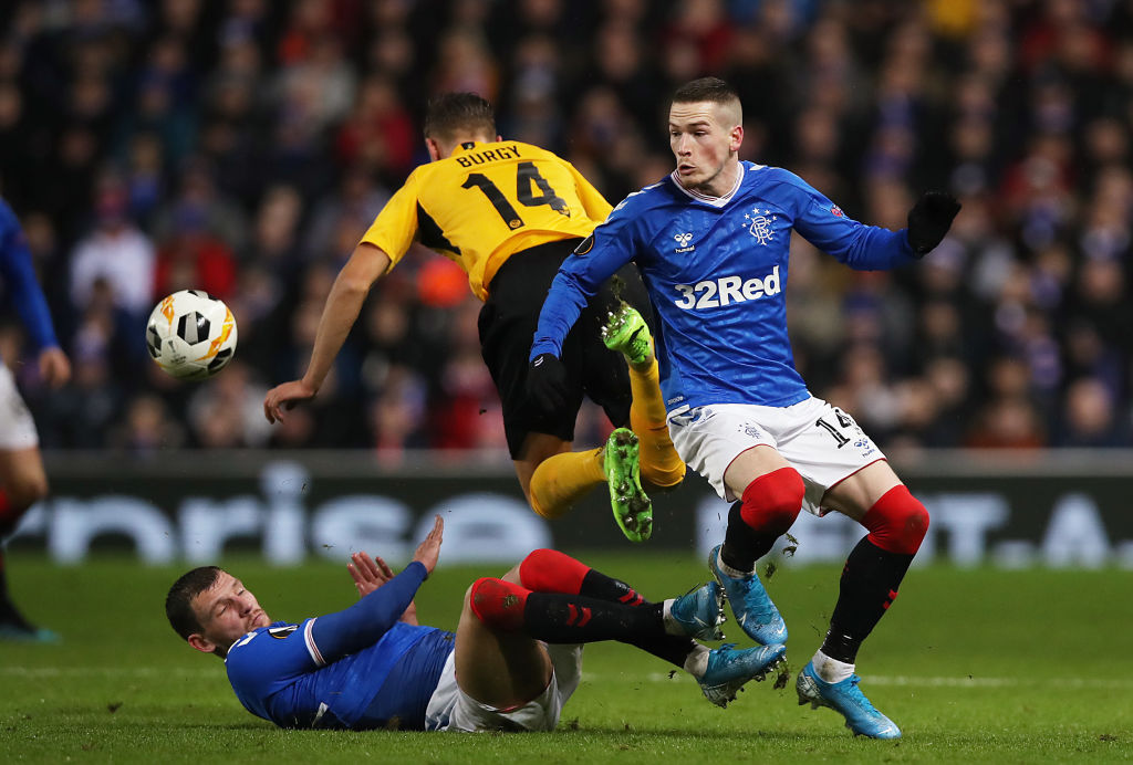 GLASGOW, SCOTLAND - DECEMBER 12: Borna Barisic and Ryan Kent of Rangers FC battle for possession with Nicolas Burgy of BSC Young Boys during the UEFA Europa League group G match between Rangers FC and BSC Young Boys at Ibrox Stadium on December 12, 2019 in Glasgow, United Kingdom. (Photo by Ian MacNicol/Getty Images)