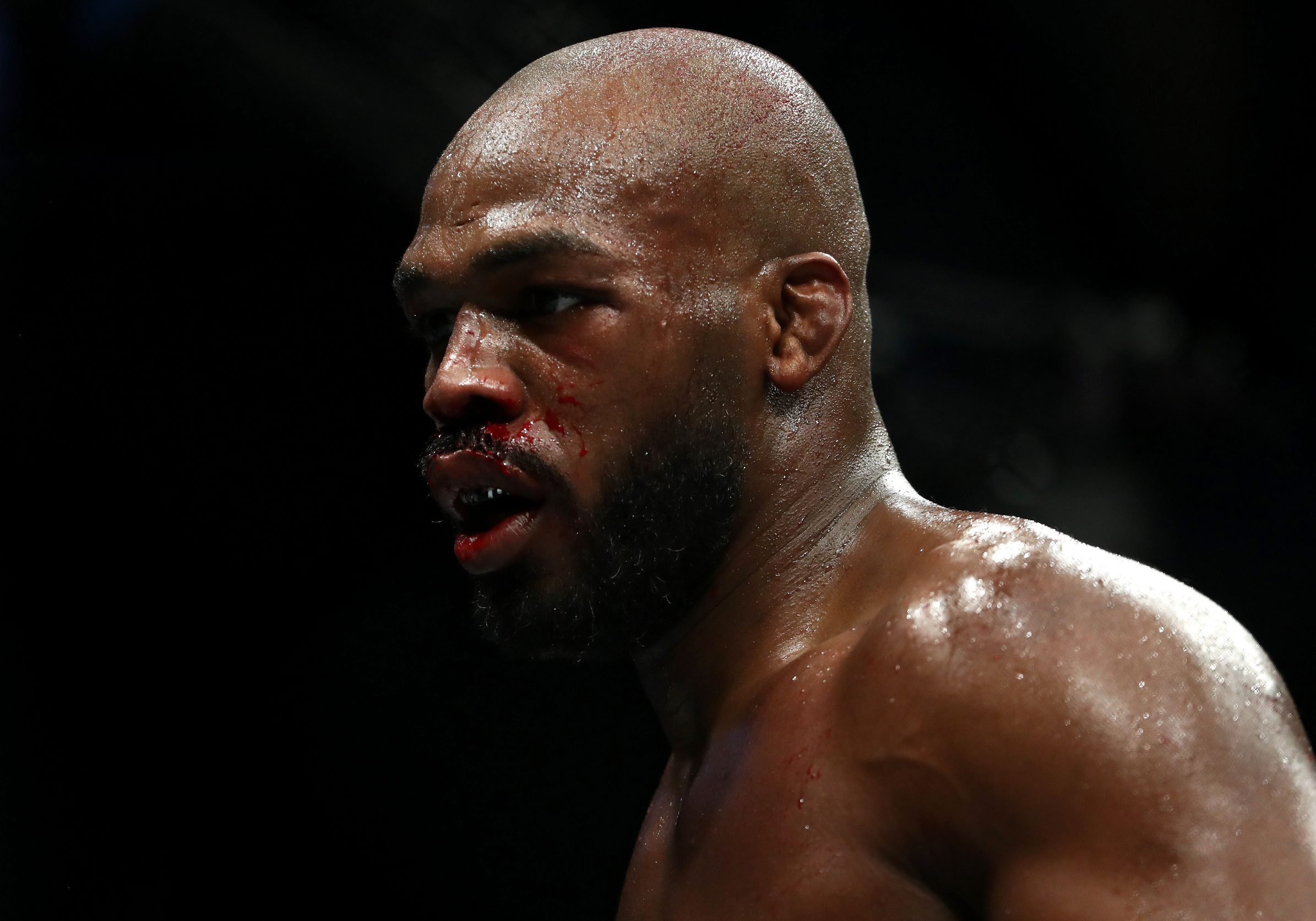 HOUSTON, TEXAS - FEBRUARY 08: Jon Jones walks to his corner in between rounds against Dominick Reyes in their UFC Light Heavyweight Championship bout during UFC 247 at Toyota Center on February 08, 2020 in Houston, Texas.   Ronald Martinez/Getty Images/AFP == FOR NEWSPAPERS, INTERNET, TELCOS & TELEVISION USE ONLY ==
