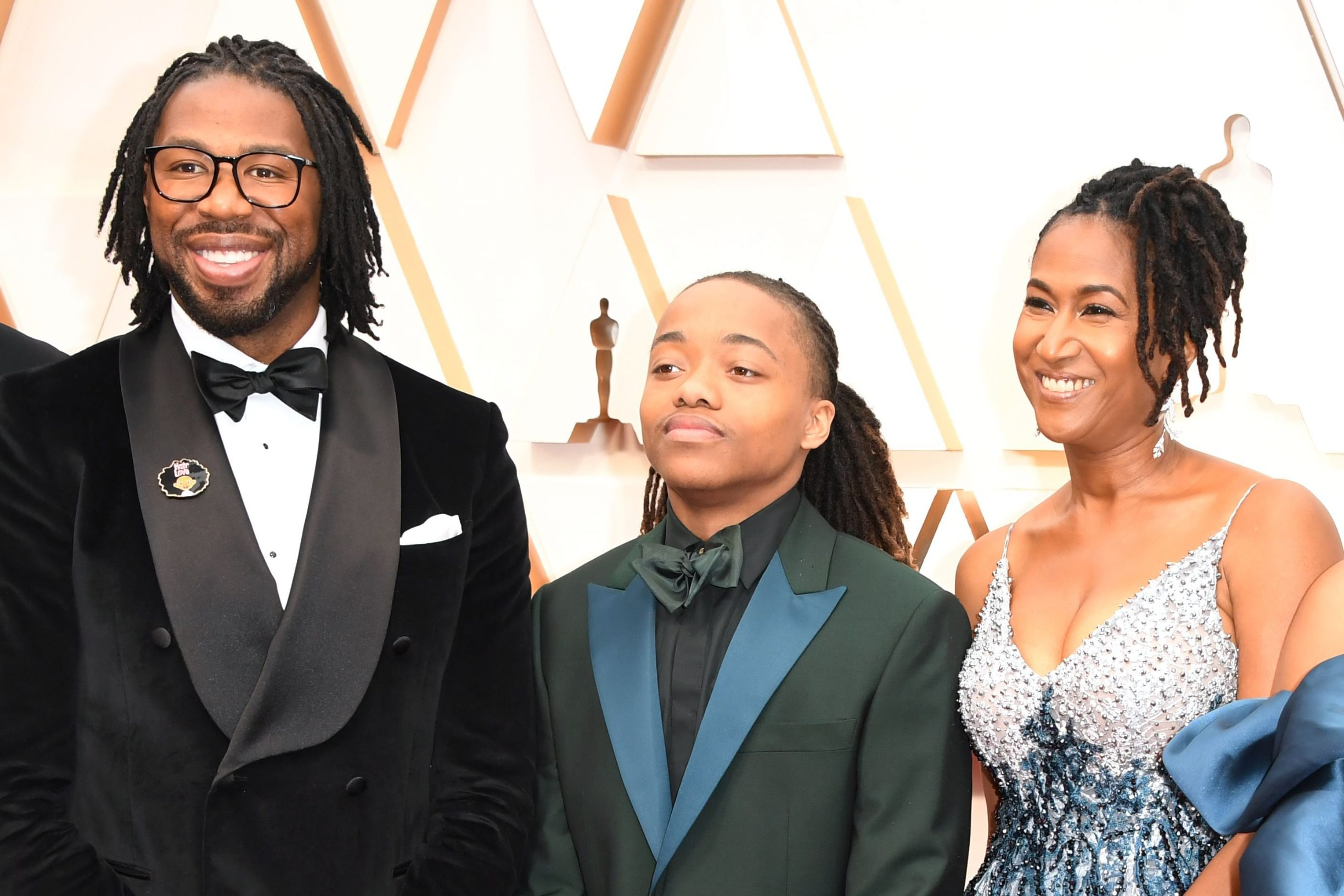 US director Matthew A. Cherry (L), US producer Karen Rupert Toliver (R) and Deandre Arnold (3rd L), the Texas teen who was told his dreadlocks violated school dress code, arrive for the 92nd Oscars at the Dolby Theatre in Hollywood, California on February 9, 2020. (Photo by Robyn Beck / AFP)