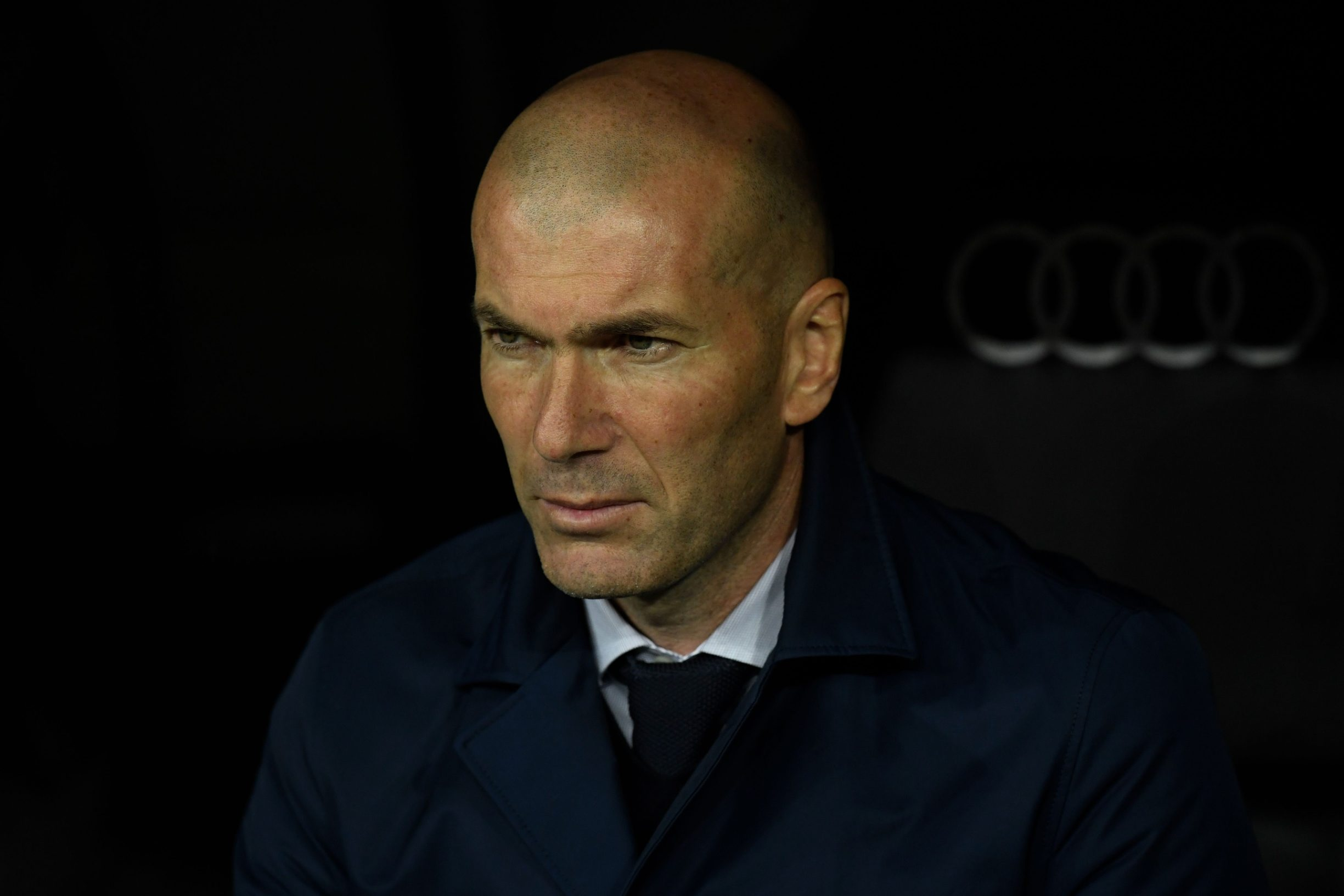 Real Madrid's French coach Zinedine Zidane waits for the start of the Spanish League football match between Real Madrid and Barcelona at the Santiago Bernabeu stadium in Madrid on March 1, 2020. (Photo by OSCAR DEL POZO / AFP)