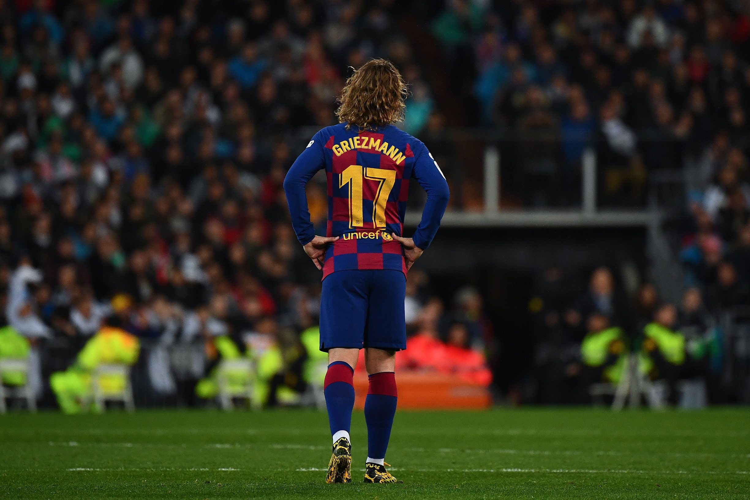 Barcelona's French forward Antoine Griezmann walks on the pitch during the Spanish League football match between Real Madrid and Barcelona at the Santiago Bernabeu stadium in Madrid on March 1, 2020. (Photo by GABRIEL BOUYS / AFP)