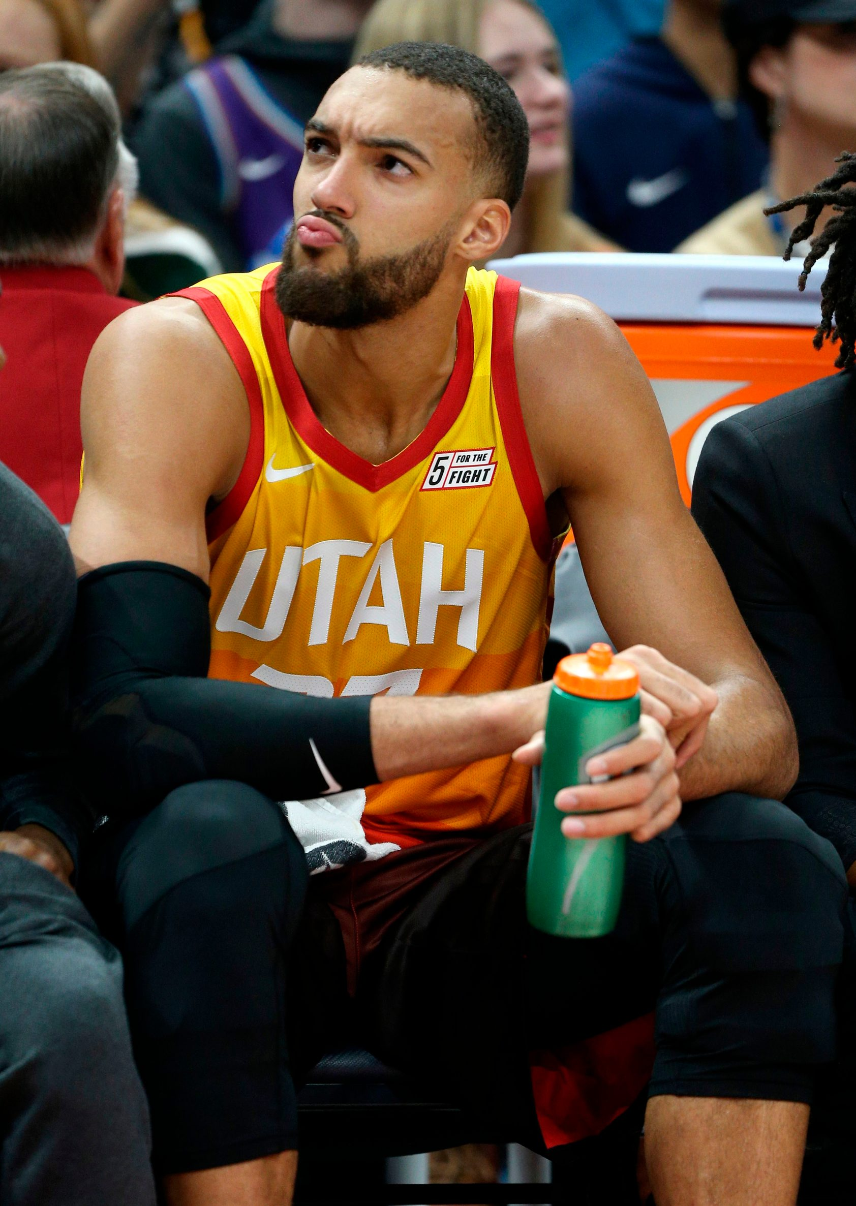 (FILES) In this file photo taken on December 04, 2019 Utah Jazz center Rudy Gobert looks at the fans in the stands during an NAB game against the Los Angeles Lakers in Salt Lake City, Utah. - The NBA will suspend play starting on Thursday after a Utah Jazz player preliminarily tested positive for the new coronavirus, the league said March 11, 2020. The test result was reported shortly before Utah's game against the Thunder in Oklahoma City was to begin, and that game was abruptly postponed. The NBA did not name the player who had tested positive, but several US media outlets reported it was French defensive standout Rudy Gobert, who was listed first as questionable for the game and then as out with illness. (Photo by GEORGE FREY / AFP)