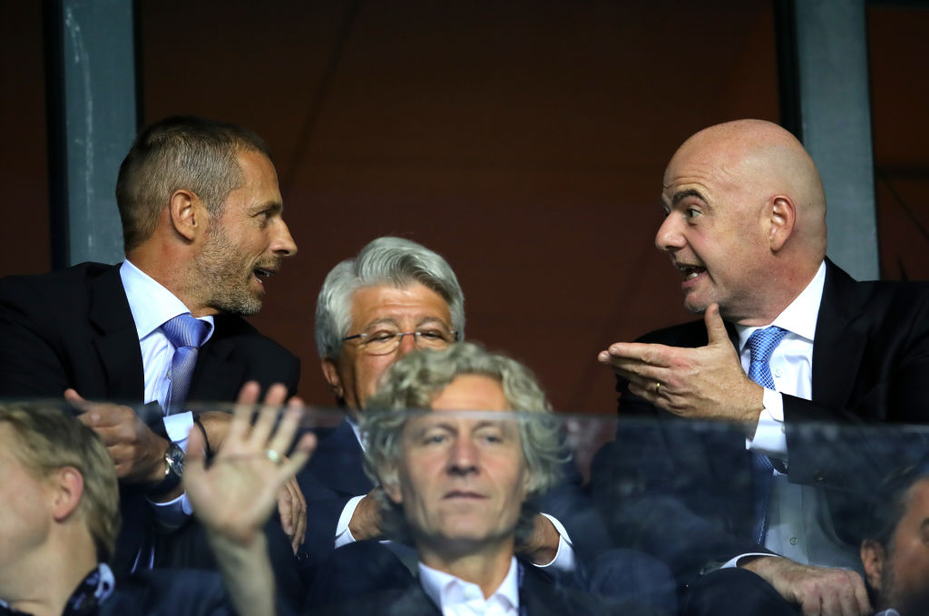 TALLINN, ESTONIA - AUGUST 15:  FIFA President, Gianni Infantino in conversation with UEFA President Aleksander Ceferin during the UEFA Super Cup between Real Madrid and Atletico Madrid at Lillekula Stadium on August 15, 2018 in Tallinn, Estonia.  (Photo by Alexander Hassenstein/Getty Images)