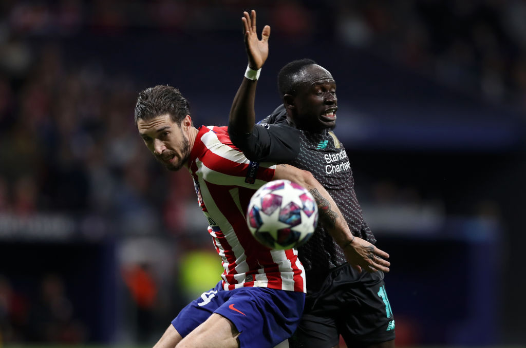 MADRID, SPAIN - FEBRUARY 18: Sime Vrsaljko of Atletico Madrid battles for possession with Sadio Mane of Liverpool during the UEFA Champions League round of 16 first leg match between Atletico Madrid and Liverpool FC at Wanda Metropolitano on February 18, 2020 in Madrid, Spain. (Photo by Angel Martinez/Getty Images)
