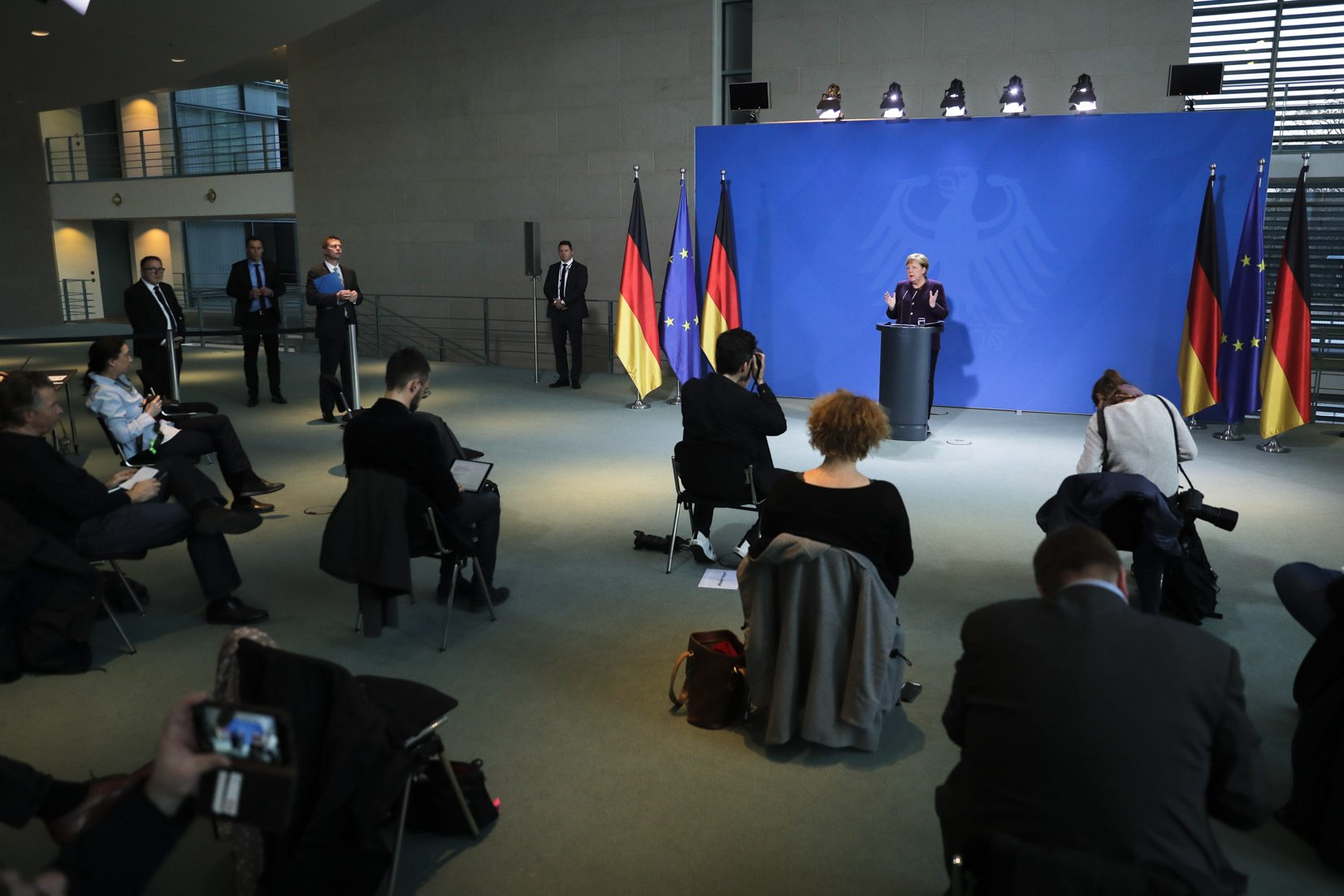 German Chancellor Angela Merkel makes a press statement, where the limited number of journalists allowed in were placed at a distance to each other, on the spread of the coronavirus COVID-19 at the Chancellery, in Berlin on March 16, 2020. (Photo by Markus Schreiber / AFP)