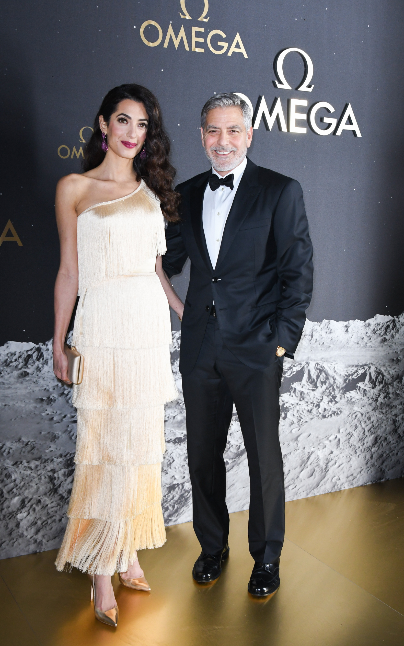 ORLANDO, FLORIDA - MAY 09: Amal Clooney and George Clooney attend OMEGA 50th Anniversary Moon Landing Event on May 09, 2019 in Orlando, Florida. (Photo by Gerardo Mora/Getty Images for OMEGA)