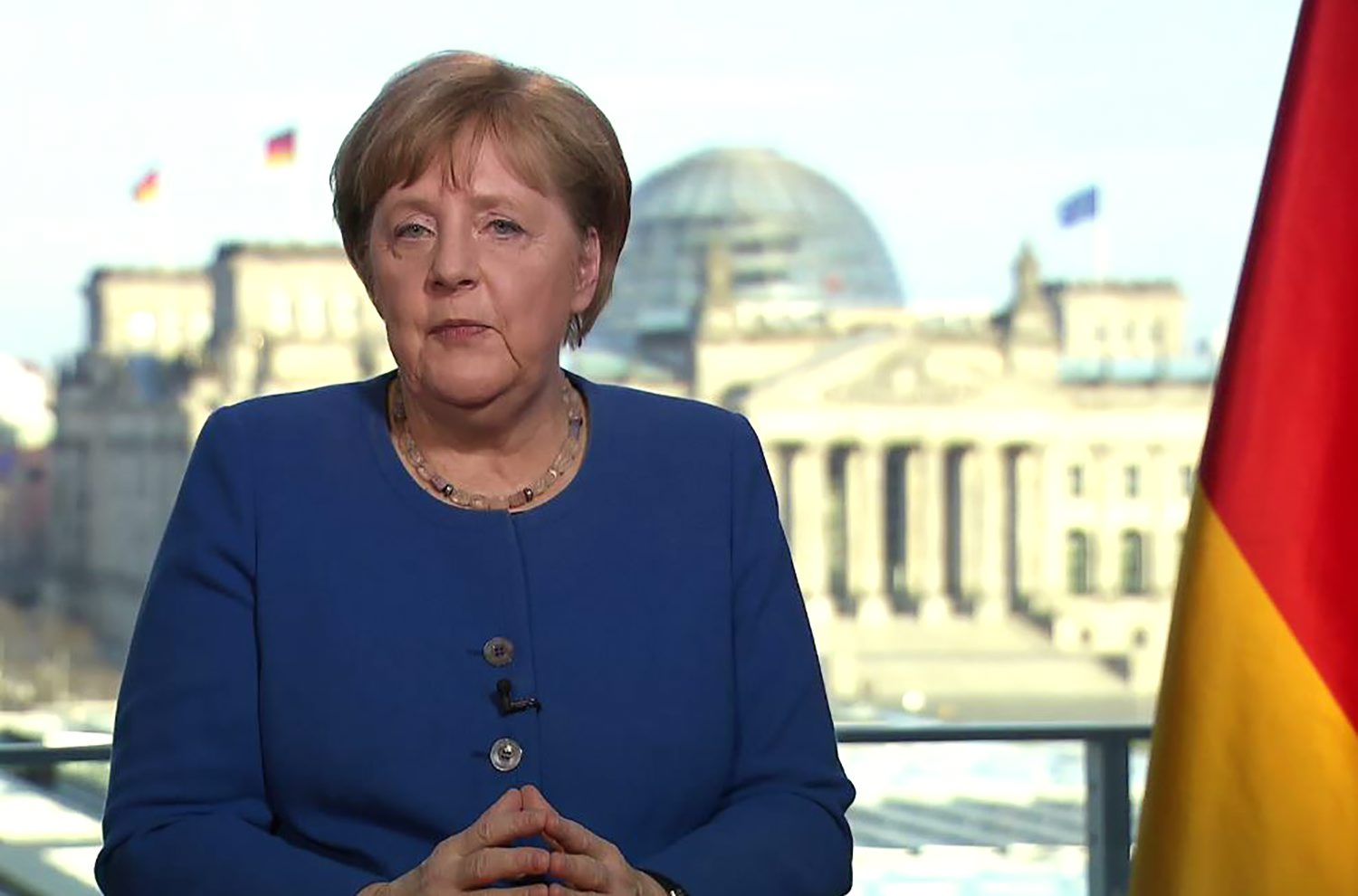 This videograb taken from German TV channel ARD on March 18, 2020 shows German Chancellor Angela Merkel addressing the nation on the spread of the new coronavirus COVID-19 at the Chancellery, with a view in the background of the Reichstag, the building housing the lower house of parliament. - Germany is facing its biggest challenge