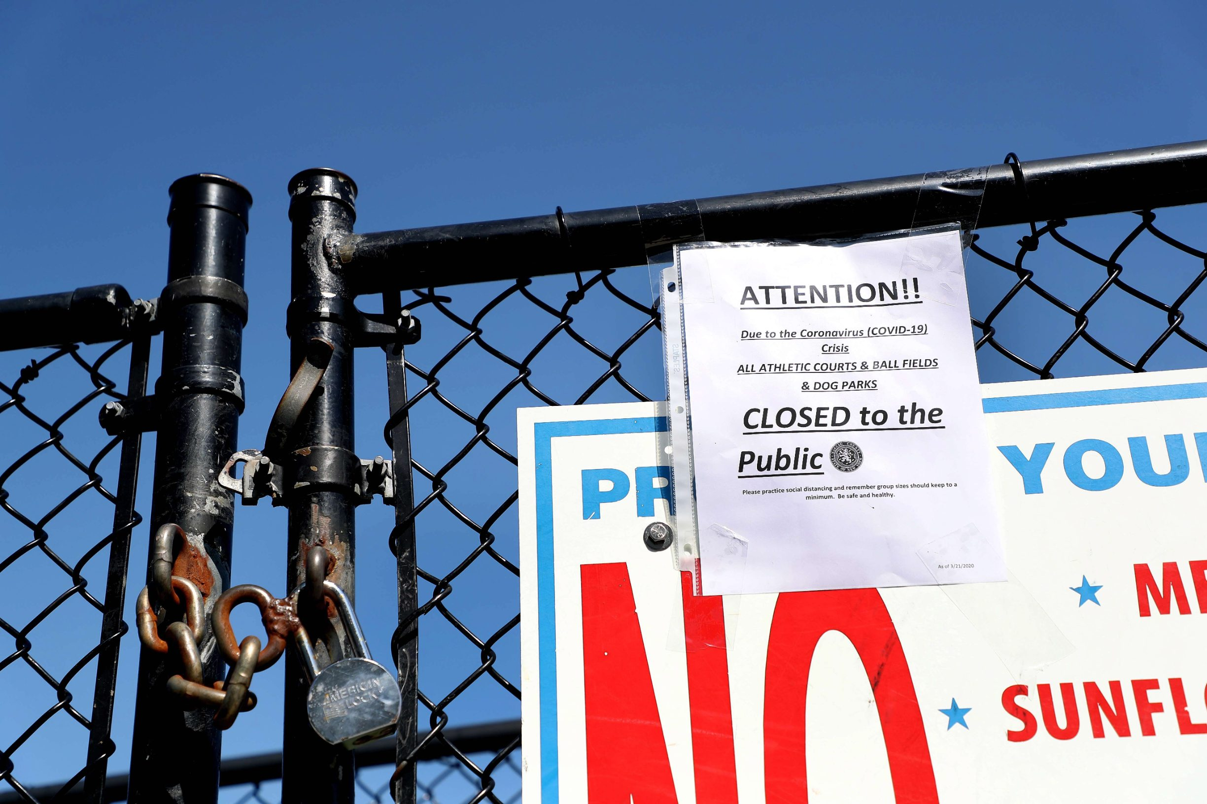 SEAFORD, NEW YORK, - MARCH 22: A sign shows that all athletic courts, ball fields, and Dog Parks are closed due to the coronavirus pandemic at Cedar Creek Park on March 20, 2020 in Seaford, New York. It has been encouraged that people keep a social distance of six feet or more to curtail the spread of the coronavirus. New York Governor Andrew Cuomo announced he was putting the state on
