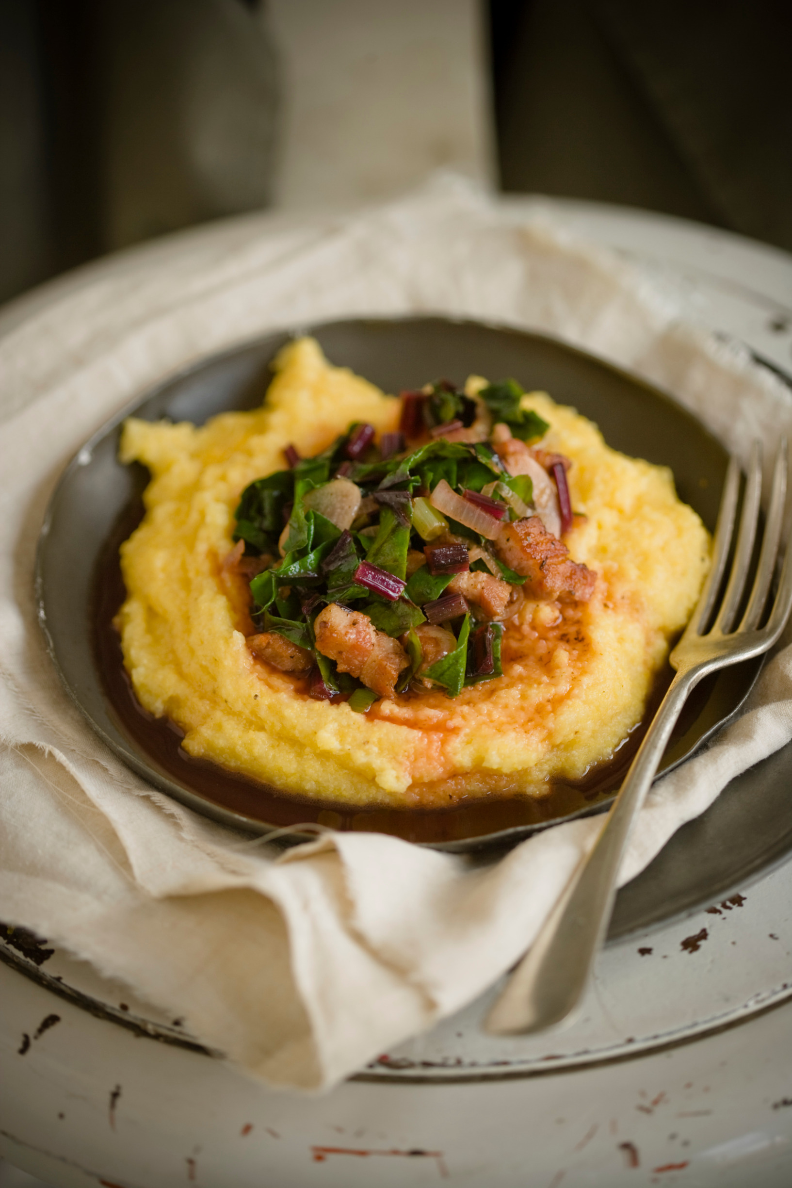 StockFood_12467277_HiRes_Polenta_with_beetroot_leaves_and_bacon