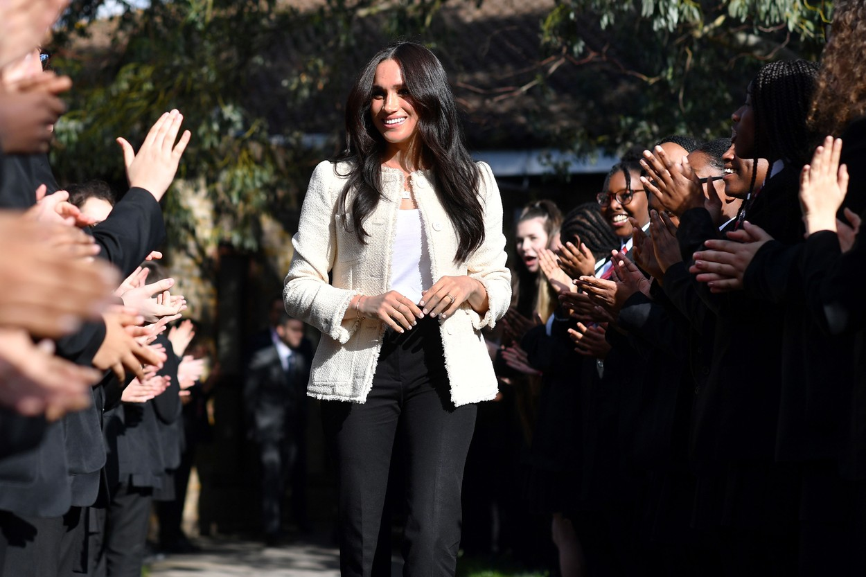 March 7, 2020, Dagenham, United Kingdom: Image licensed to i-Images Picture Agency. 07/03/2020. Dagenham, United Kingdom. Meghan Markle, the Duchess of Sussex , is welcomed by students during a visit to Robert Clack School in Dagenham,United Kingdom, in support of International WomenÕs Day., Image: 504432454, License: Rights-managed, Restrictions: * China, France, Italy, Spain, Taiwan and UK Rights OUT *, Model Release: no, Credit line: Pool / Zuma Press / Profimedia