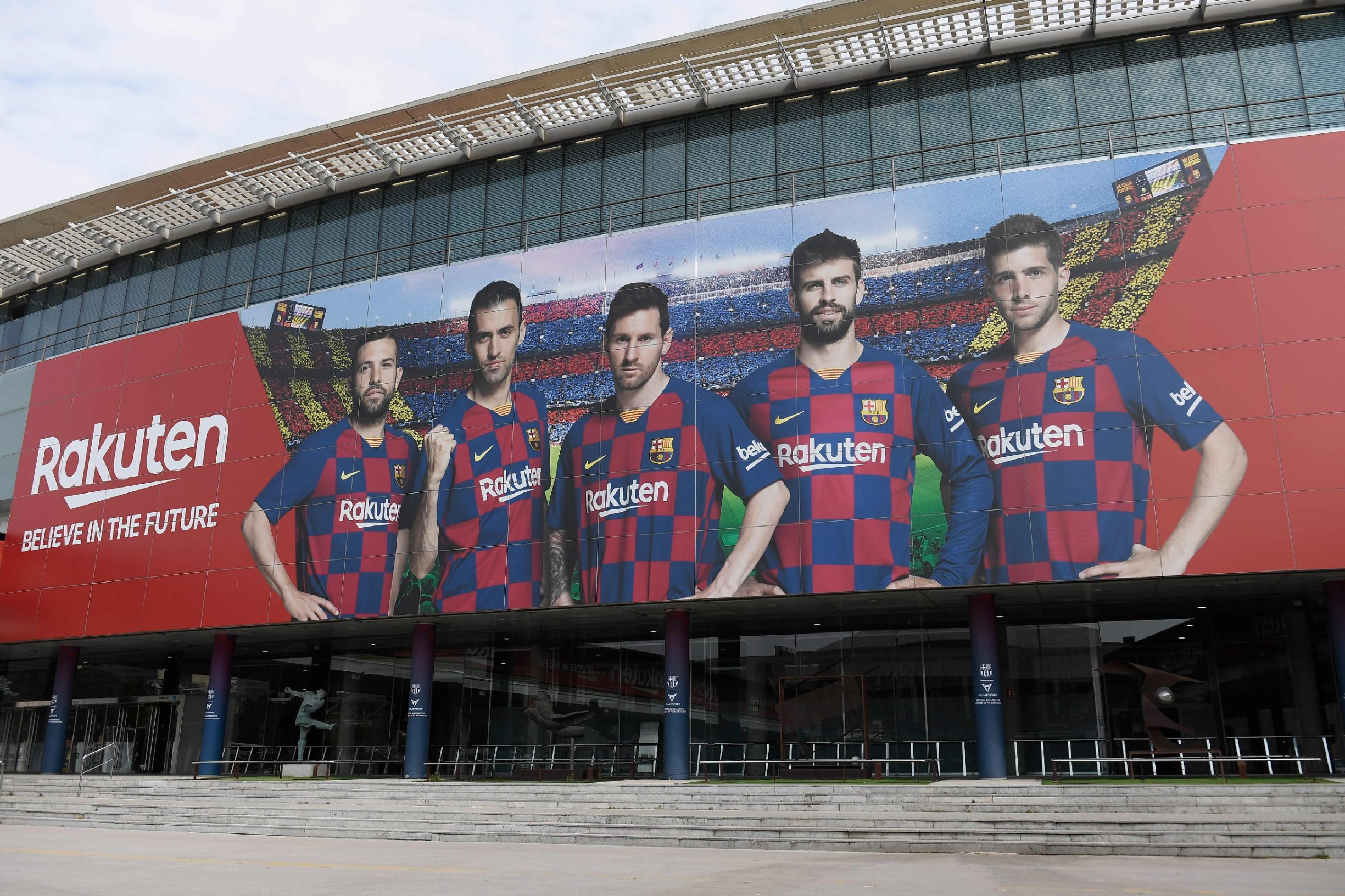 A picture shows the empty entrance to the Camp Nou stadium in Barcelona on March 13, 2020 after La Liga said Spain's top two divisions would be suspended for at least two weeks over the coronavirus outbreak. (Photo by Josep LAGO / AFP)