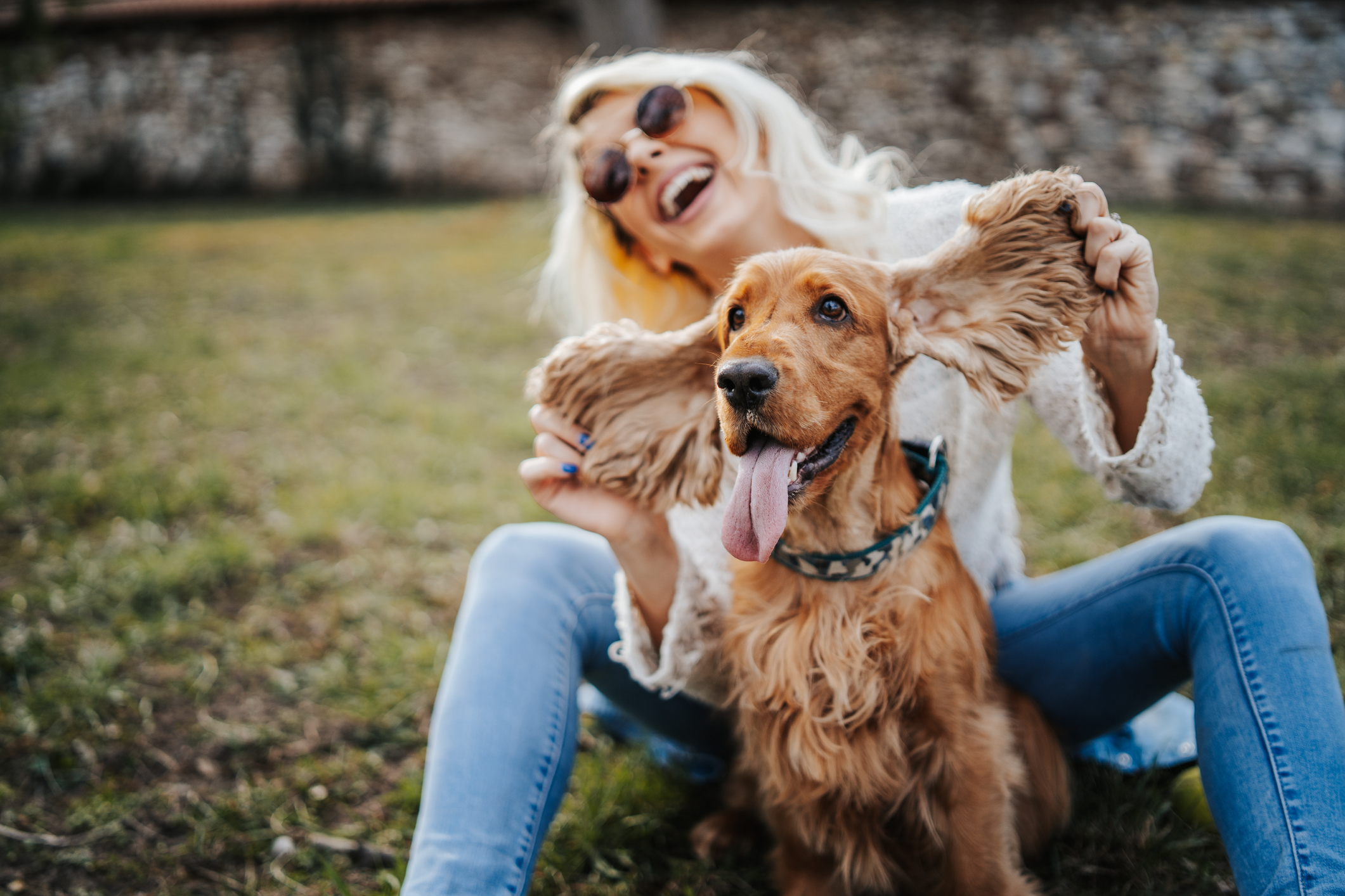 Young woman playing dog in park
