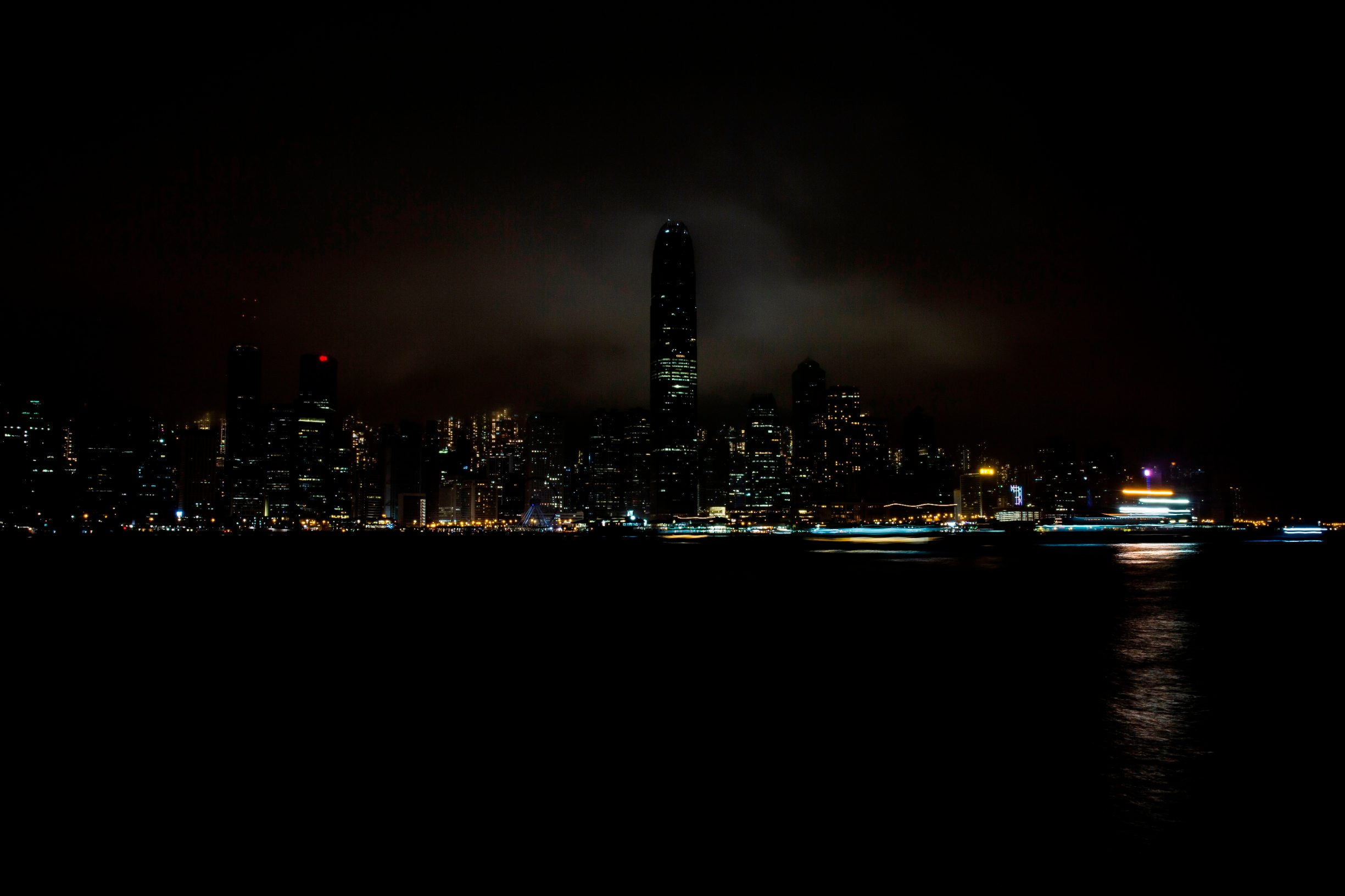 Part of the skyline of Hong Kong is seen with some of its lights turned off to mark the Earth Hour environmental campaign on March 28, 2020. (Photo by Isaac LAWRENCE / AFP)