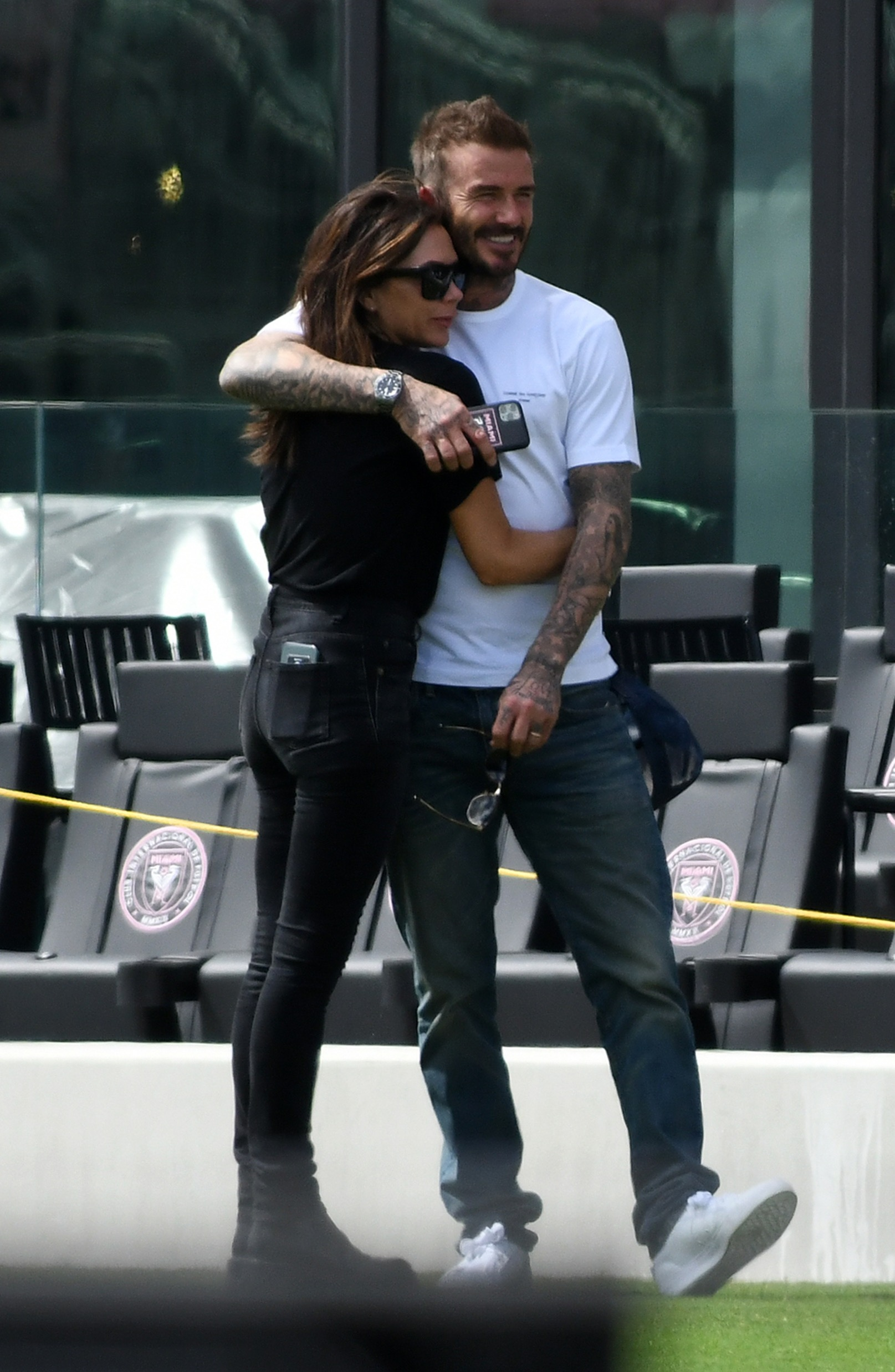 *PREMIUM EXCLUSIVE * David Beckham tenderly kisses wife Victoria as the entire family visits the temporary new home of his Miami football team. Brooklyn, 21, Romeo, 17, Cruz 15, and Harper, eight, joined their proud father for a personal tour of his team's stadium. Brooklyn, who turned 21 last week, packed on the PDA with American actress Nicola Peltz, 25, as did Romeo with his girlfriend Mia Regan. Victoria seemed to be having a ball and was seen dancing to music by the Spice Girls. The visit came after  fashion designer Victoria, 45, took to Instagram to update fans on her familys decision to travel to Miami to support husband David, also 45, for the launch of his football team Inter Miami CF. The former Manchester United and England star was just two games into the season when the Major Soccer League announced they have suspended their league season for the next 30 days because of coronavirus fears. 14 Mar 2020, Image: 506559728, License: Rights-managed, Restrictions: World Rights, Model Release: no, Credit line: Splash News/MEGA / The Mega Agency / Profimedia