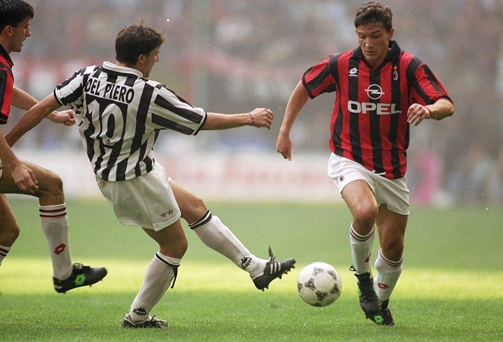 15 Oct 1995:  Stefano Eranio (right) of AC Milan takes on Alessandro del Piero of Juventus during a Series A match at the San Siro Stadium in Milan, Italy. AC Milan won the match 2-1. \ Mandatory Credit: Ben  Radford/Allsport