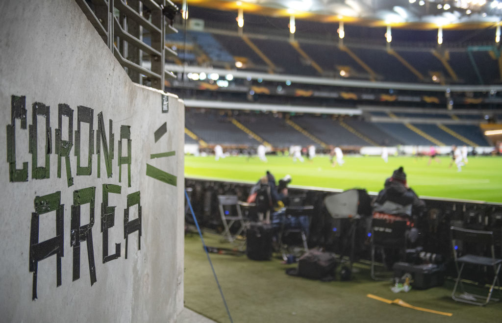 FRANKFURT AM MAIN, GERMANY - MARCH 12: A sign named Corona Area is seen inside the stadium during the UEFA Europa League round of 16 first leg match between Eintracht Frankfurt and FC Basel at Commerzbank Arena on March 12, 2020 in Frankfurt am Main, Germany. The match is played behind closed doors as a precaution against the spread of COVID-19 (Coronavirus). (Photo by Matthias Hangst/Bongarts/Getty Images)