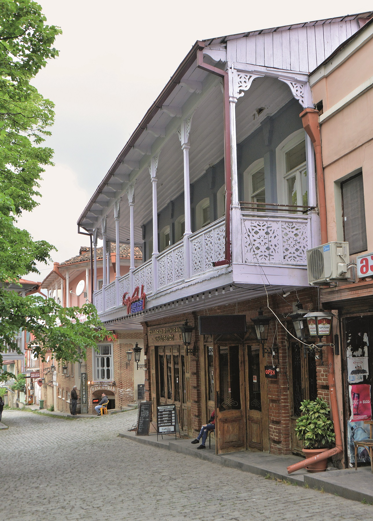 Old house with a big wooden balcony in the mostly renovated historical old town Sighnaghi (Signagi) in Georgia (Kakheti), recorded on 21.05.2019 | usage worldwide