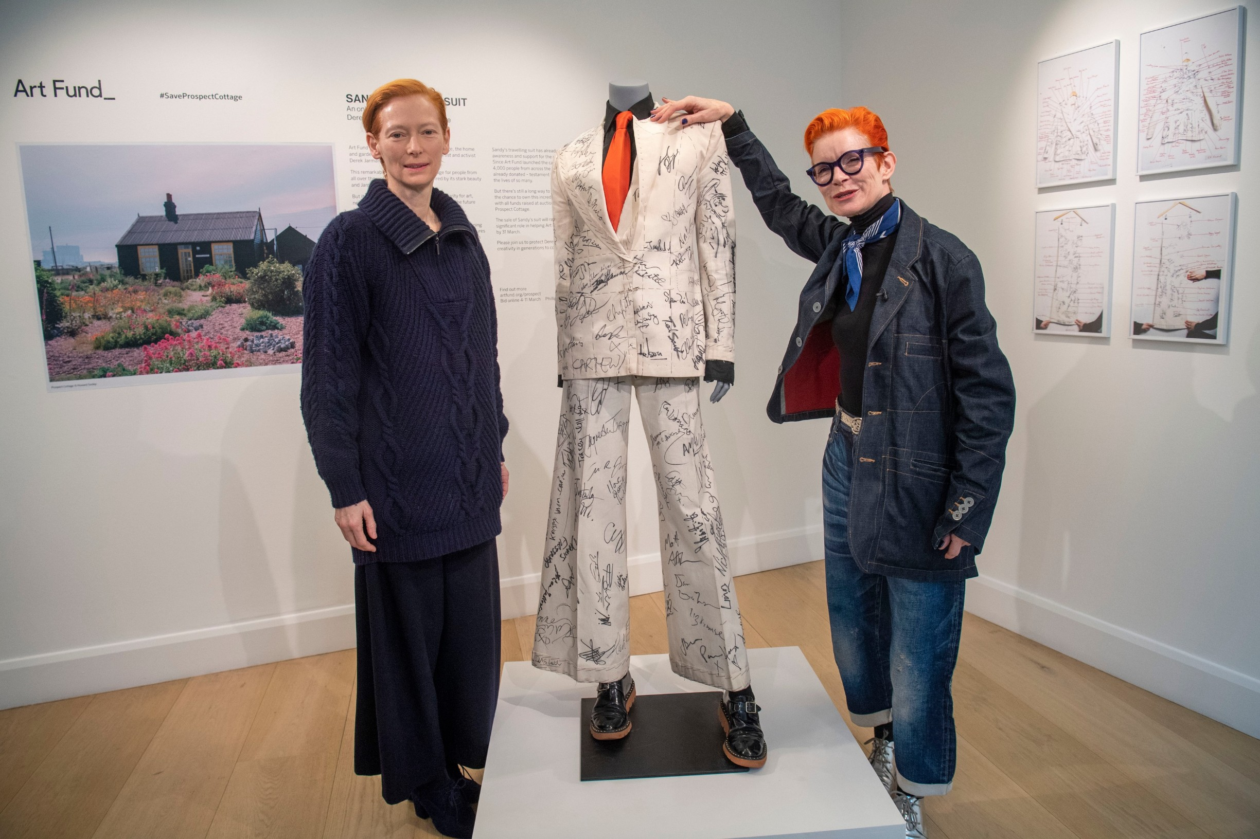 March 4, 2020, London, London, United Kingdom: Image licensed to i-Images Picture Agency. 04/03/2020. London, United Kingdom. Actress Tilda Swinton with costume designer Sandy Powell and her Oscars suit signed by stars before it is offered at auction.  Proceeds from the auction will go towards Art Fund's public appeal to save and protect Prospect Cottage in Dungeness, Kent, United Kingdom., Image: 503289741, License: Rights-managed, Restrictions: * China, France, Italy, Spain, Taiwan and UK Rights OUT *, Model Release: no, Credit line: I-Images / Zuma Press / Profimedia