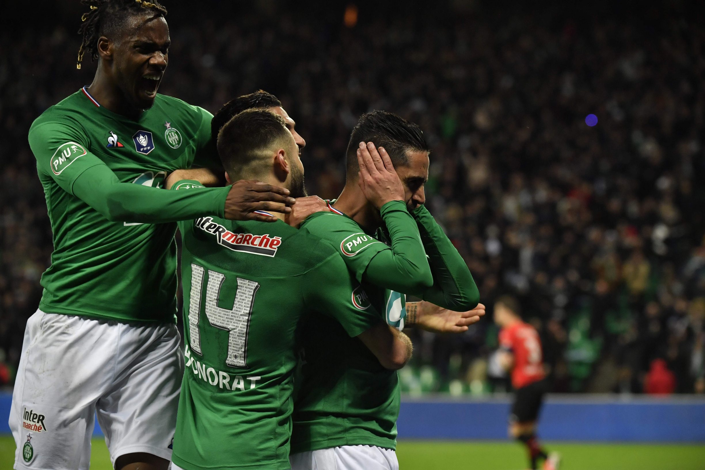 Saint-Etienne's Algerian midfielder Ryad Boudebouz (R) is congratuled by teamates after scoring a goal during the French Cup semi-final match between AS Saint-Etienne (ASSE) and Stade Rennais FC (Rennes) on March 5, 2020, at the Geoffroy Guichard stadium in Saint-Etienne, central France. (Photo by PHILIPPE DESMAZES / AFP)