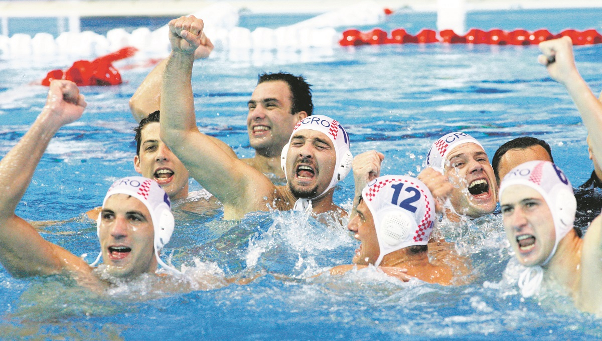 Croatian players celebrate their victory over Hungary in extra time 01 April 2007 after the Croatia vs Hungary final match of the 12th Fina World Swimming Championships in Melbourne. Croatia won gold, Hungary silver and Spain took bronze.AFP PHOTO / TORSTEN BLACKWOOD (Photo by TORSTEN BLACKWOOD / AFP)