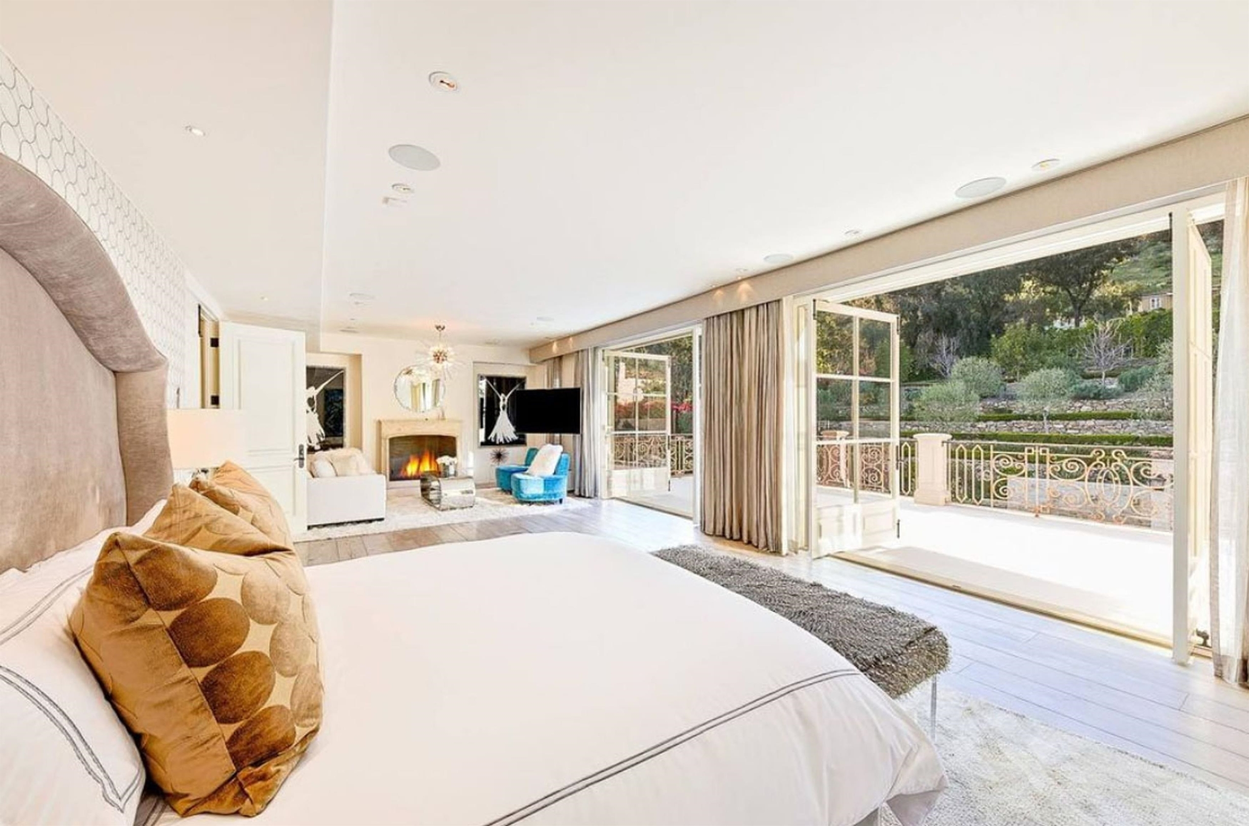 Los Angeles, CA  - Prince Harry and Meghan Markle eyeing Kylie Jenner's former Malibu rental house. Although they're currently bunking up in a  million Vancouver mansion, it's long been widely speculated that the ex-royals eventually plan to settle in Los Angeles, where Markle was raised and where her mother, Doria Ragland, still resides. The residential rumours intensified when reports emerged that Harry and Markle are keen on one particular Malibu house: a hulking, European-style mansion known as Petra Manor, tucked away within an exclusive guard-gated community. Reports have the home worth between  million and   million. Malibu's Petra Manor was once home to the biggest influencers of them all — 22-year-old lip kit tycoon Kylie Jenner, who rented the house over the summer 2018. Jenner bunked up there with her ex-bestie, fellow influencer Jordyn Woods, and a then-newborn Stormi Webster. Petra Manor was custom-built in 2015 by David Charvet and Brooke Burke, on land that they originally purchased from Mel Gibson. The giant house still appears to be jointly owned by the now-divorced couple, though they do not reside there, and the property has long serviced as a high-priced rental home for visiting billionaires and foreign dignitaries seeking a brief taste of Malibu's legendary sunshine. The house is located within Serra Retreat, one of Malibu's few guard-gated communities and arguably the city's most private enclave — tucked into the canyon-side foothills and bordered by rugged open land, but still just a quick jaunt to the trendy shops and restaurants in downtown Malibu. Although it's hidden away within that securely guard-gated community, the property itself is also walled and gated for ultimate peace of mind. Surrounded by mature oak and sycamore trees, the stone manor spans more than 12,000 sq ft of living space, with 8 bedrooms and a whopping 10 bathrooms — ample space for a young family and plenty of attitude. Inside, there's a double-height foyer with a grand staircase, a marble-topped wet bar, professional-style screening room, eat-in kitchen with top-of-the-line stainless appliances and a wine cellar capable of storing hundreds of bottles. Other features include massive living and family rooms, both outfitted with fireplaces, an upstairs master with a spa-style bath and private balcony, and even an at-home dance studio. Outdoors, there's mature olive trees, formal gardens, outdoor lounge, resort-style swimming pool with Baja shelf.  *BACKGR  BACKGRID UK 24 FEBRUARY 2020, Image: 500637764, License: Rights-managed, Restrictions: RIGHTS: WORLDWIDE EXCEPT IN UNITED STATES, Model Release: no, Credit line: VRBO / BACKGRID / Backgrid UK / Profimedia
