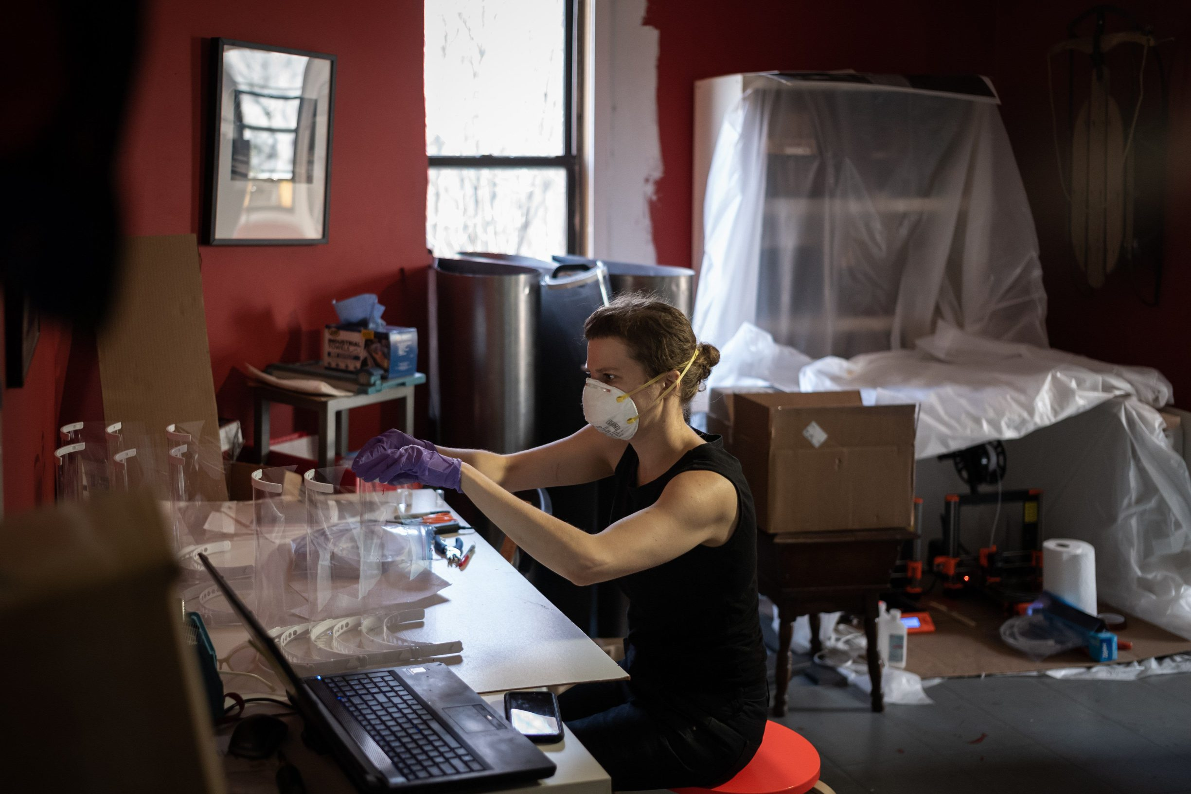 NEW YORK, NY - MARCH 27: Artist Luba Drozd makes protective shields for health workers in her apartment on her 3D printers on March 27, 2020 in Brooklyn, New York. Together with friends, she started a GoFundMe campaign to raise money to buy more supplies and printers. Since launching her campaign on March 24, she is overwhelmed with requests for PPEs from frontline healthcare workers. The World Health Organization declared coronavirus (COVID-19) a global pandemic on March 11.   Misha Friedman/Getty Images/AFP == FOR NEWSPAPERS, INTERNET, TELCOS & TELEVISION USE ONLY ==