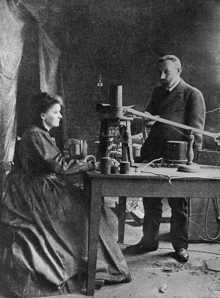 Marie Curie (1867 - 1934) Polish -born French physicist in her laboratory with husband Pierre (1859 - 1906), eminent French chemist.   (Photo by Hulton Archive/Getty Images)