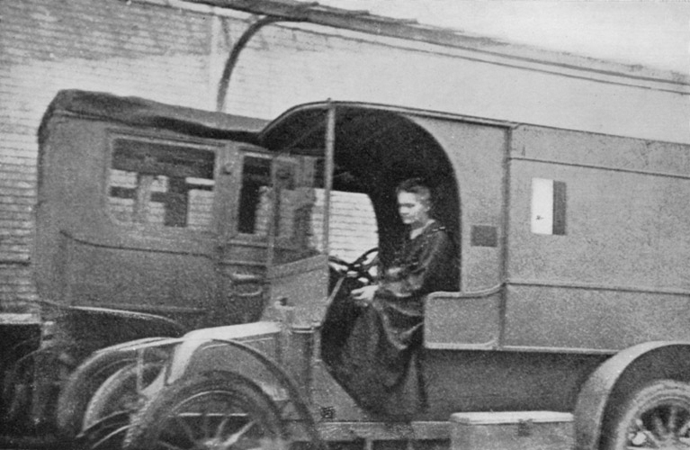 Marie Curie driving one of her mobile x-ray units. INTIMATE black and white photos of legendary chemist and physicist, Marie Curie, have resurfaced today, her 150th birthday. The images show Curie, born Maria Skłodowska, being received by then US President Warren G. Harding, at the White House to be presented with a gram of radium. Others offer a glimpse into her personal life from her early life with her family to striking portraits of the scientist not long before her death. Public Domain / mediadrumworld.com, Image: 354837853, License: Rights-managed, Restrictions: , Model Release: no, Credit line: Public Domain / mediadrumworld.c / Media Drum World / Profimedia
