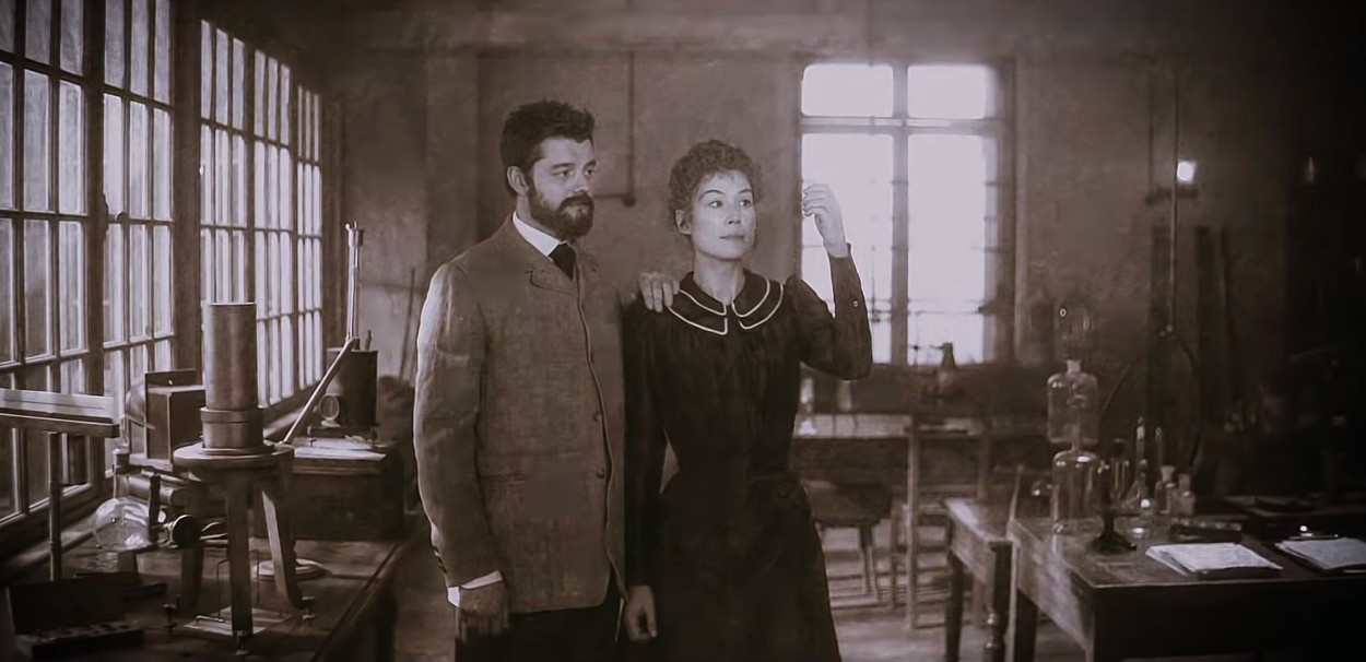 France . Rosamund Pike and Sam Riley  in the ©Amazon Studios new movie: Radioactive (2019) . Plot: A story of the scientific and romantic passions of Marie Sklodowska-Curie (Polish scientist) and Pierre Curie, and the reverberation of their discoveries throughout the 20th century., Image: 498615628, License: Rights-managed, Restrictions: Supplied by Landmark Media. Editorial Only. Landmark Media is not the copyright owner of these Film or TV stills but provides a service only for recognised Media outlets., Model Release: no, Credit line: ©Amazon Studios  / Supplied by LMK / Landmark / Profimedia