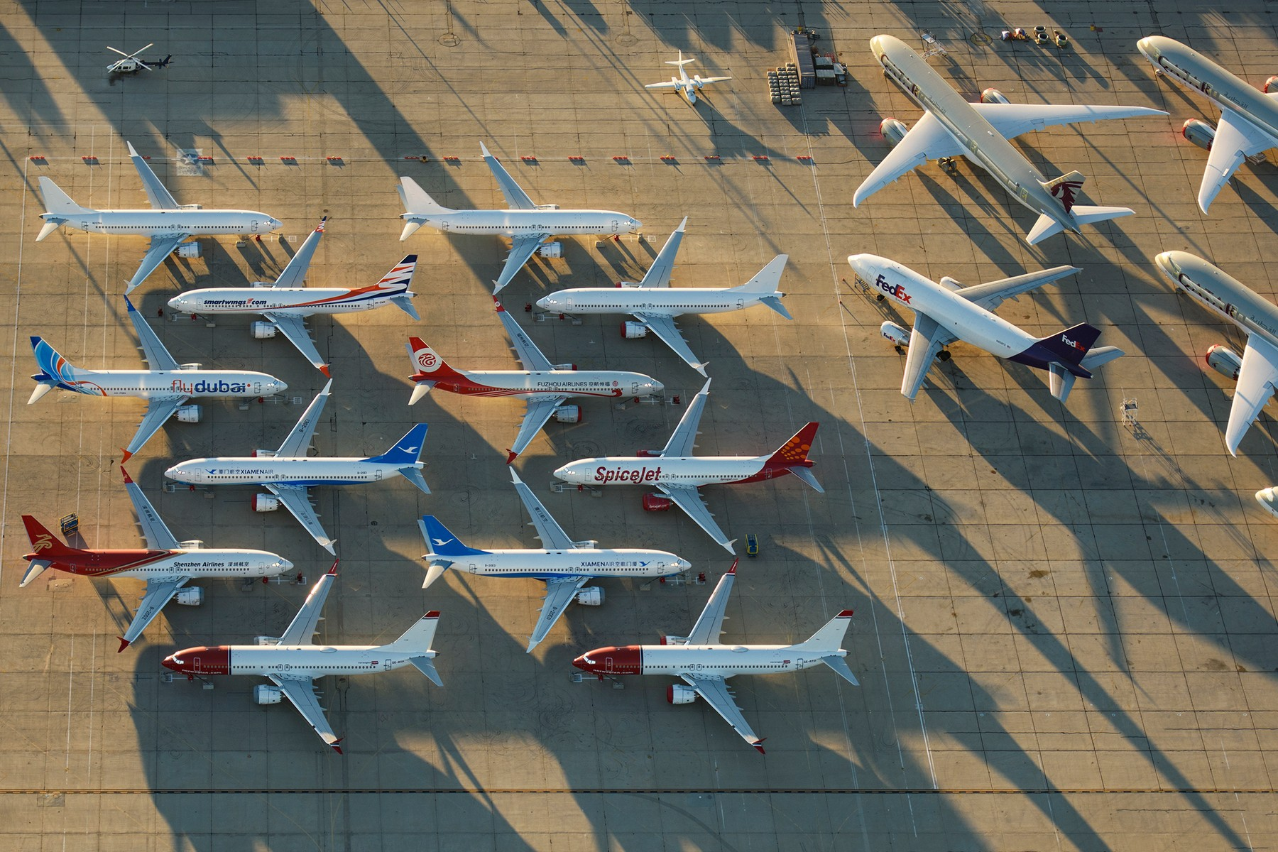Pictured: Around 50 - 60 Boeing 737 Max, from 12 different airlines, are seen grounded at Victorville Airport in the Mojave Desert in California, USA.  Jassen Todorov took these images from his 1976 Piper Warrior Plane, as the one year anniversary approaches next month.  As a pilot himself, Jassen said