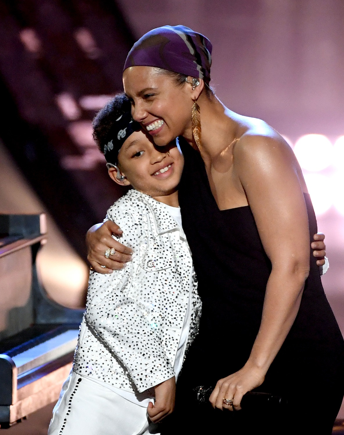 LOS ANGELES, CALIFORNIA - MARCH 14: (EDITORIAL USE ONLY. NO COMMERCIAL USE)  Alicia Keys and her son Egypt Daoud Dean perform onstage at the 2019 iHeartRadio Music Awards which broadcasted live on FOX at Microsoft Theater on March 14, 2019 in Los Angeles, California. (Photo by Kevin Winter/Getty Images for iHeartMedia)