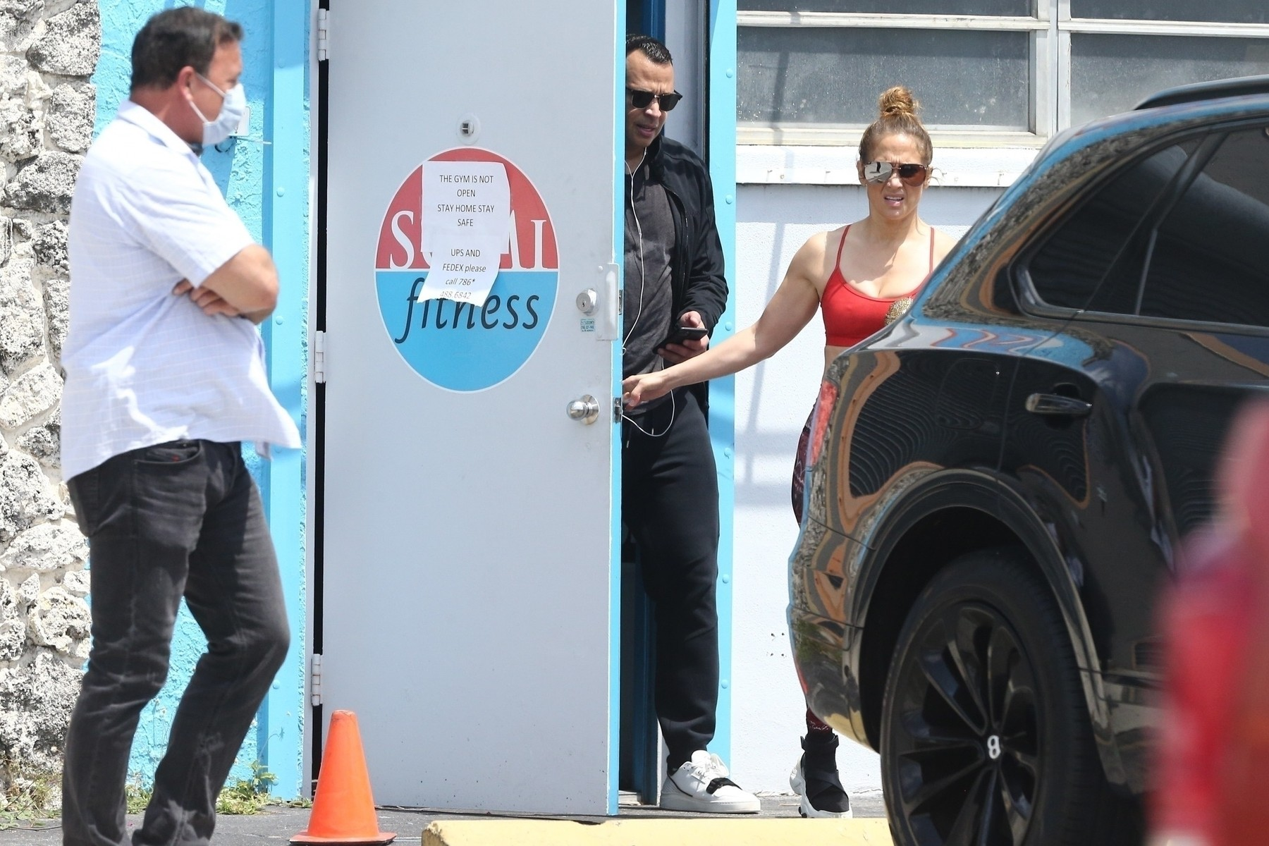 Miami, FL  - *EXCLUSIVE*  - Jennifer Lopez and Alex Rodriguez are seen for the first time since the COVID-19 self-quarantine and hit up their local gym.  Jennifer's security wore a mask and made sure to wipe down door handles and any surfaces they may come in contact with.  Interesting though that the gym is clearly closed with a sign posted on the door, which proves both Jennifer and Alex have the star power.  *UK Clients - Pictures Containing Children Please Pixelate Face Prior To Publication*, Image: 511300101, License: Rights-managed, Restrictions: RIGHTS: WORLDWIDE EXCEPT IN UNITED KINGDOM, Model Release: no, Credit line: MiamiPIXX / BACKGRID / Backgrid USA / Profimedia
