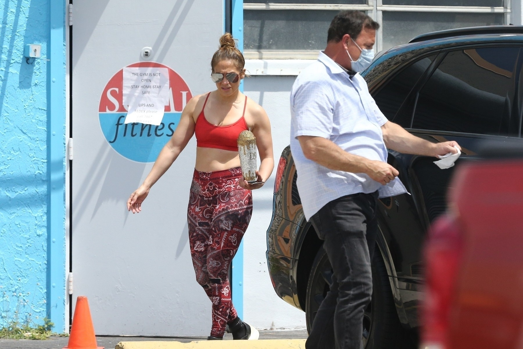 Miami, FL  - *EXCLUSIVE*  - Jennifer Lopez and Alex Rodriguez are seen for the first time since the COVID-19 self-quarantine and hit up their local gym.  Jennifer's security wore a mask and made sure to wipe down door handles and any surfaces they may come in contact with.  Interesting though that the gym is clearly closed with a sign posted on the door, which proves both Jennifer and Alex have the star power.  *UK Clients - Pictures Containing Children Please Pixelate Face Prior To Publication*, Image: 511300119, License: Rights-managed, Restrictions: RIGHTS: WORLDWIDE EXCEPT IN UNITED KINGDOM, Model Release: no, Credit line: MiamiPIXX / BACKGRID / Backgrid USA / Profimedia